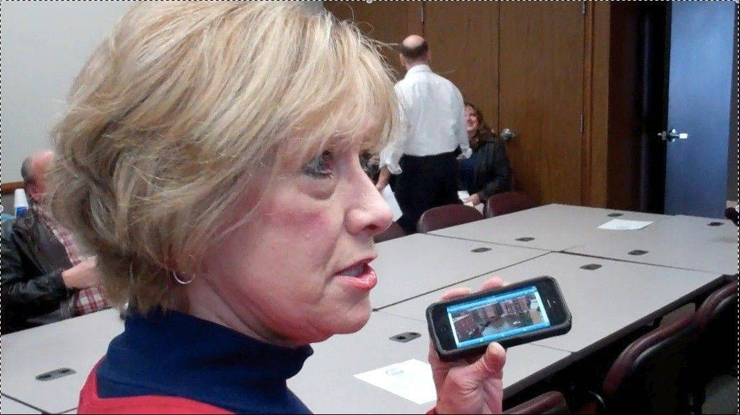 Des Plaines First Ward Alderman Patricia Haugeberg shows a photo of the damage to her building.