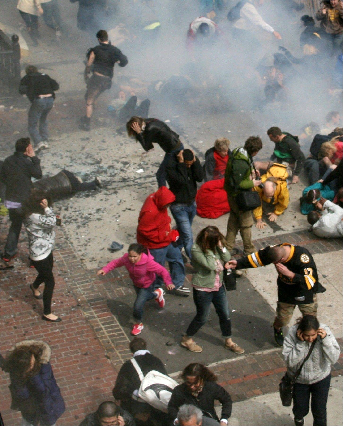 People react to an explosion Monday at the 2013 Boston Marathon in Boston.