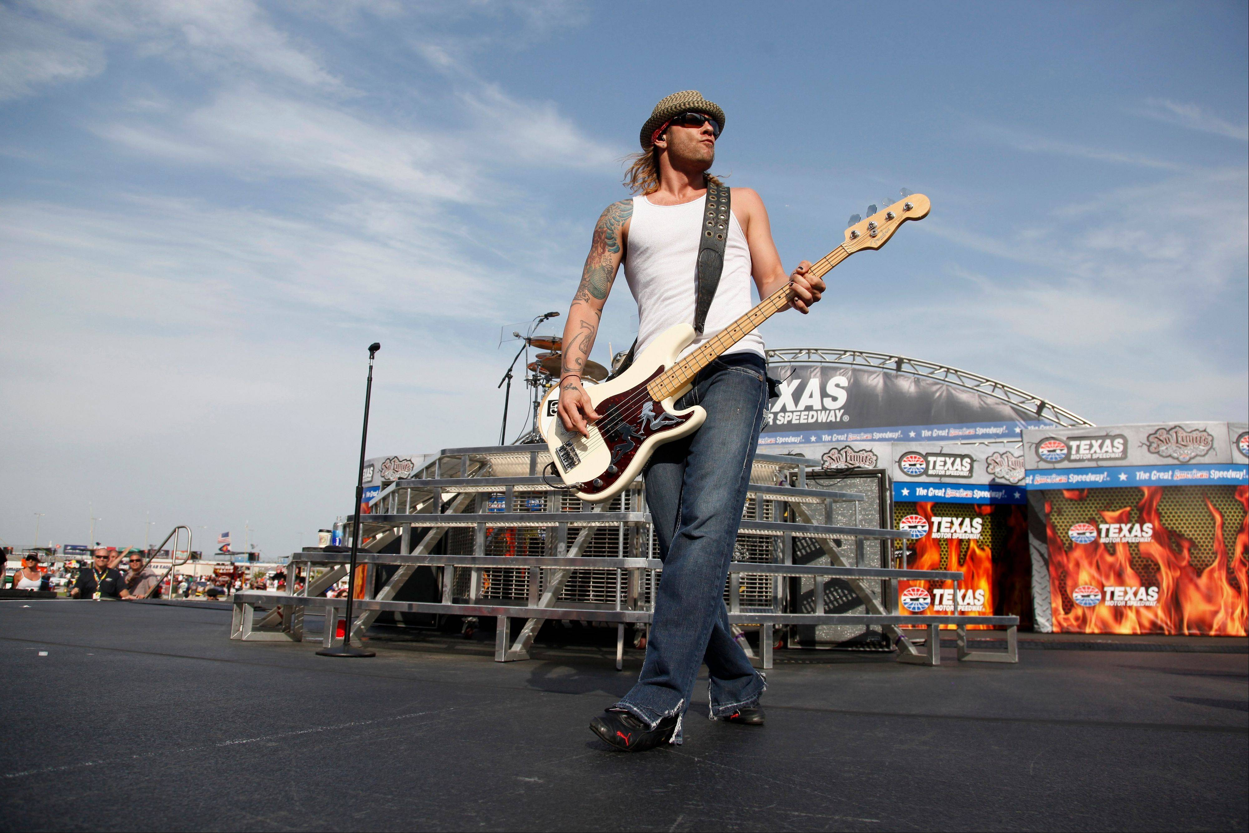 3 Doors Down' bassist Todd Harrell performs before a NASCAR race at Texas Motor Speedway in Fort Worth, Texas, in 2011. Harrell has been charged with vehicular homicide by intoxication in a fatal crash near Nashville.