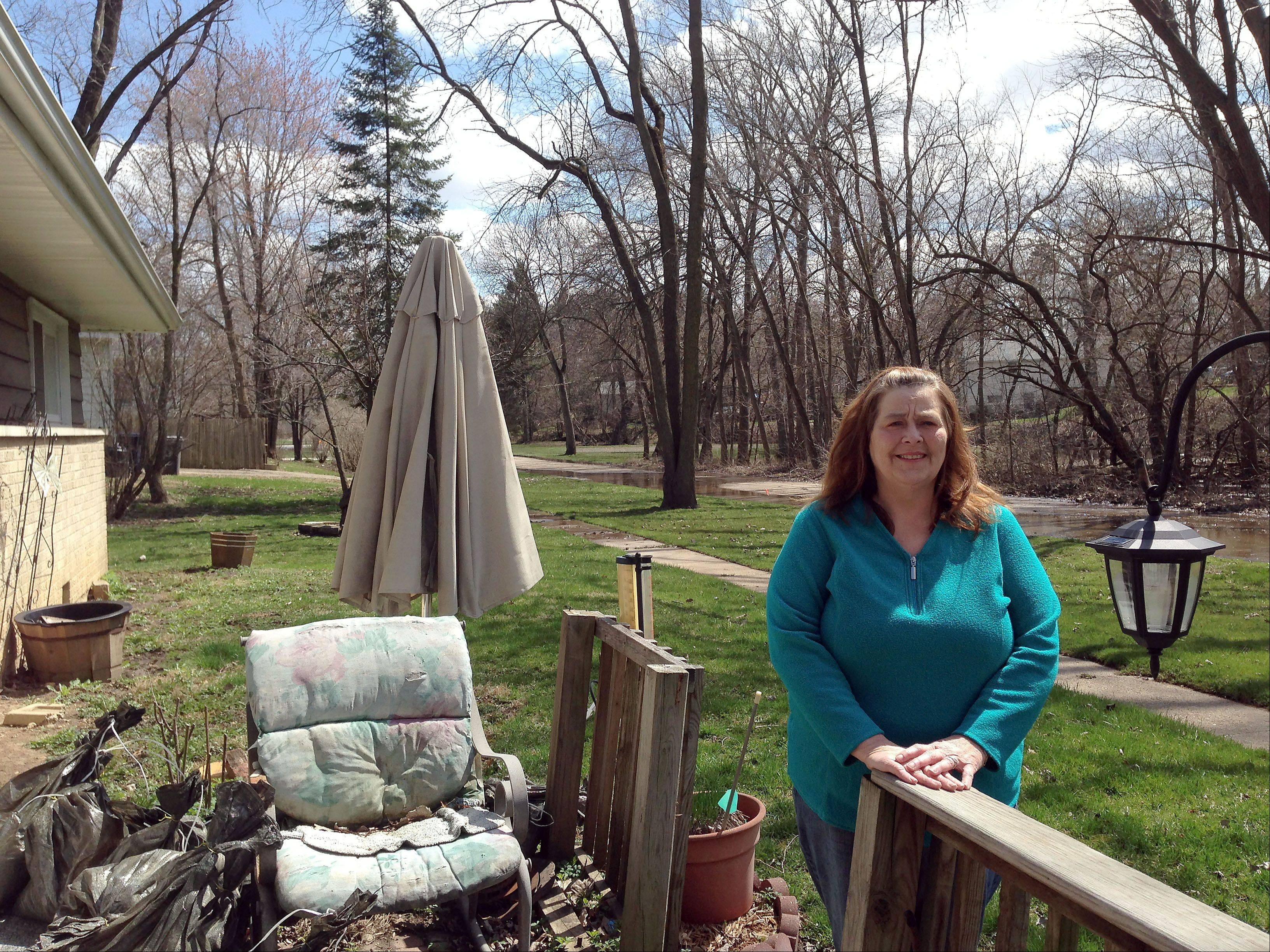 ELENA FERRARIN/eferrarin@dailyherald.comSpring and fall are always stressful times for Lorie Granderson, who lives in her childhood home on Willard Avenue, across the street from Willow Creek in Elgin. Last week's storms were the second worst in memory, with the water stopping 7 to 8 feet from her garage.