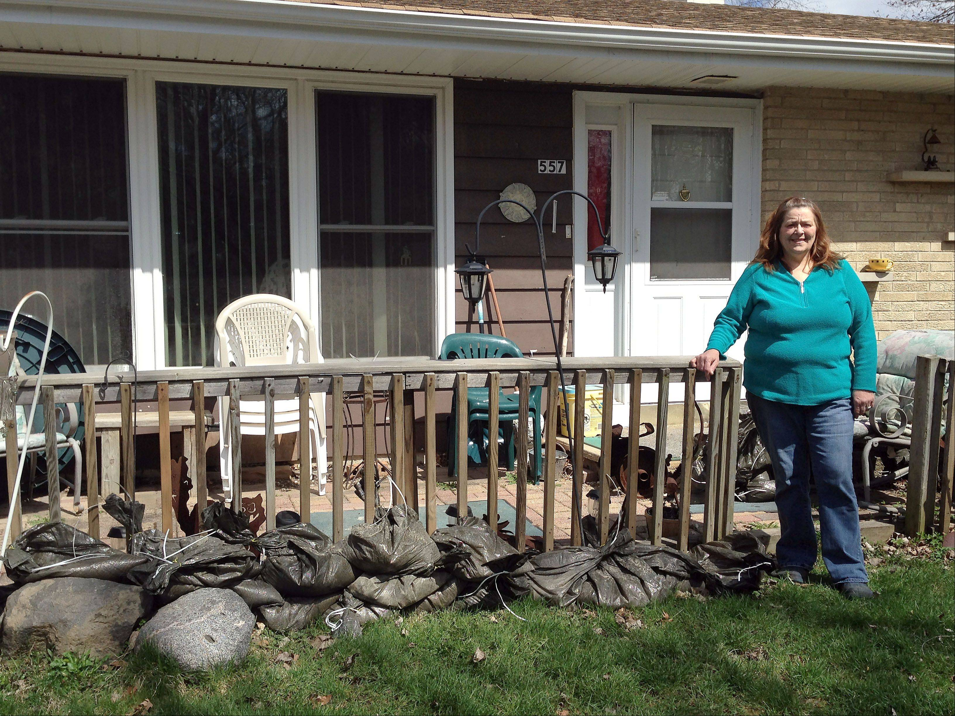 Spring and fall are always stressful times for Lorie Granderson, who lives in her childhood home on Willard Avenue, across the street from Willow Creek in Elgin. Last week's storms were the second worst in memory, with the water stopping 7 to 8 feet from her garage.