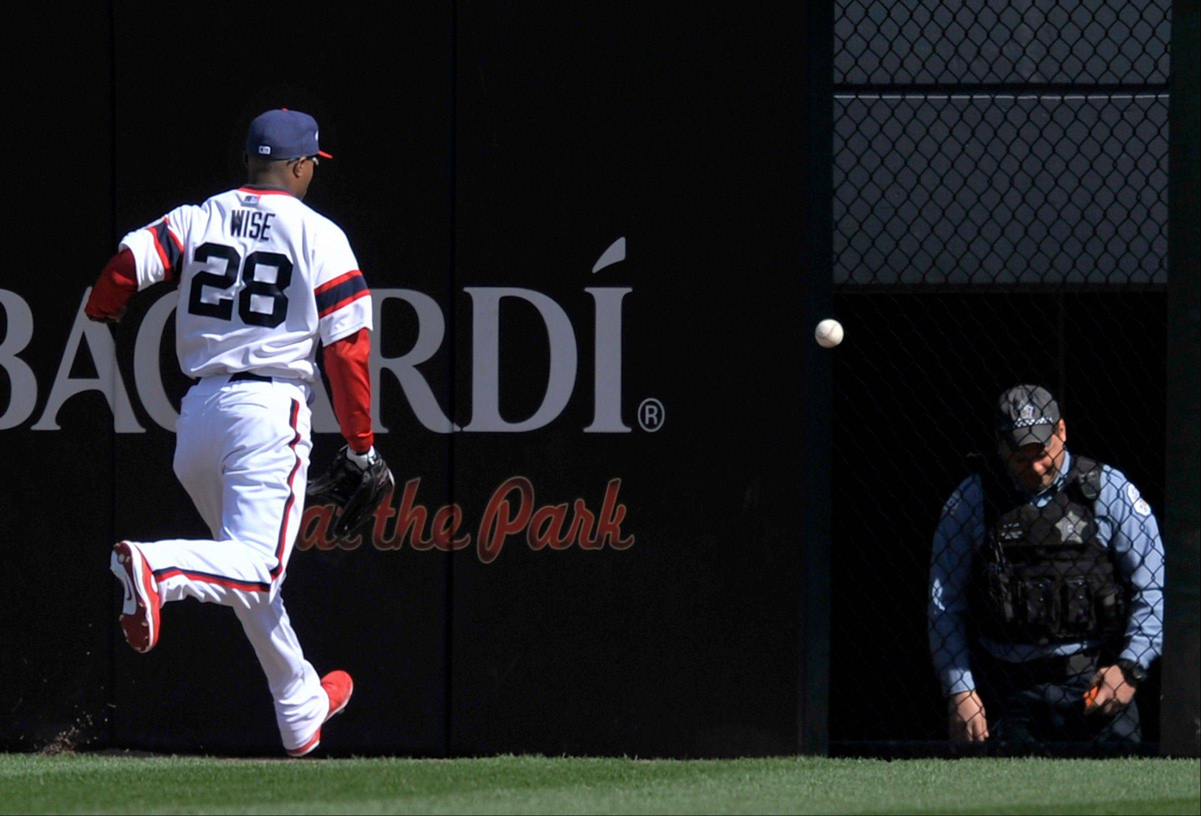 White Sox center fielder Dewayne Wise chases down a 3-run double by the Twins' Josh Willingham during the seventh inning Sunday at U.S. Cellular Field.