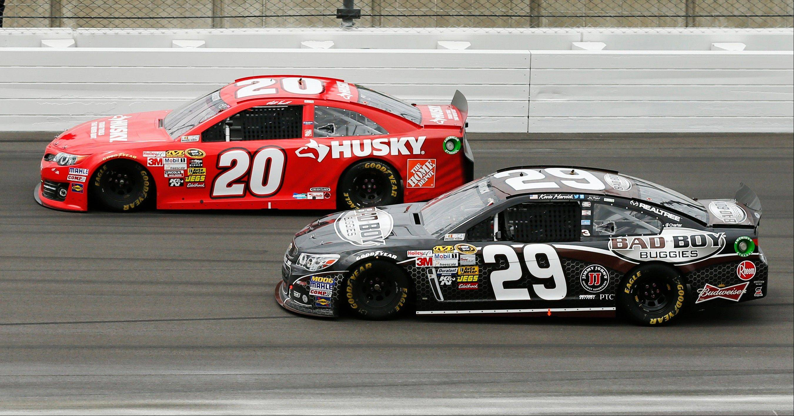 Driver Matt Kenseth, top, leads Kevin Harvick during the NASCAR Sprint Cup series race Sunday at Kansas Speedway in Kansas City, Kan.