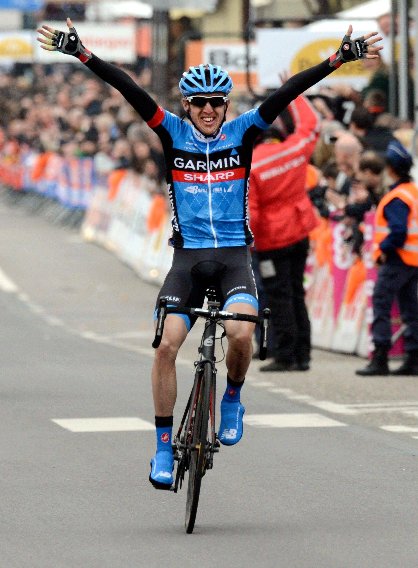 Daniel Martin of the Garmin-Sharp team celebrates Sunday as he crosses the finish line to win the Liege-Bastogne-Liege cycling classic in Belgium.