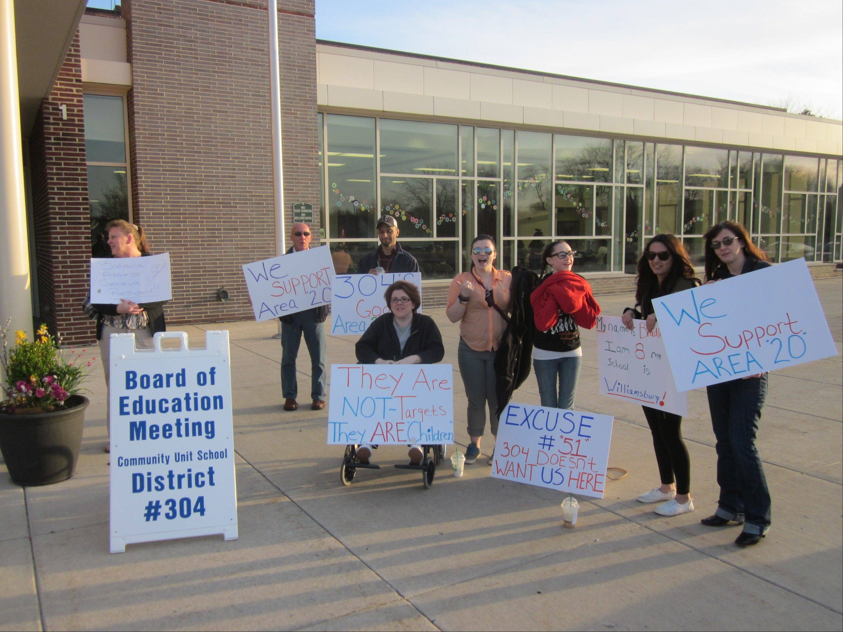 Parents of children who attend Williamsburg Elementary School in Geneva protest before a Geneva school board meeting Monday night at the school. The board is moving their children next school year to Western Avenue Elementary School.