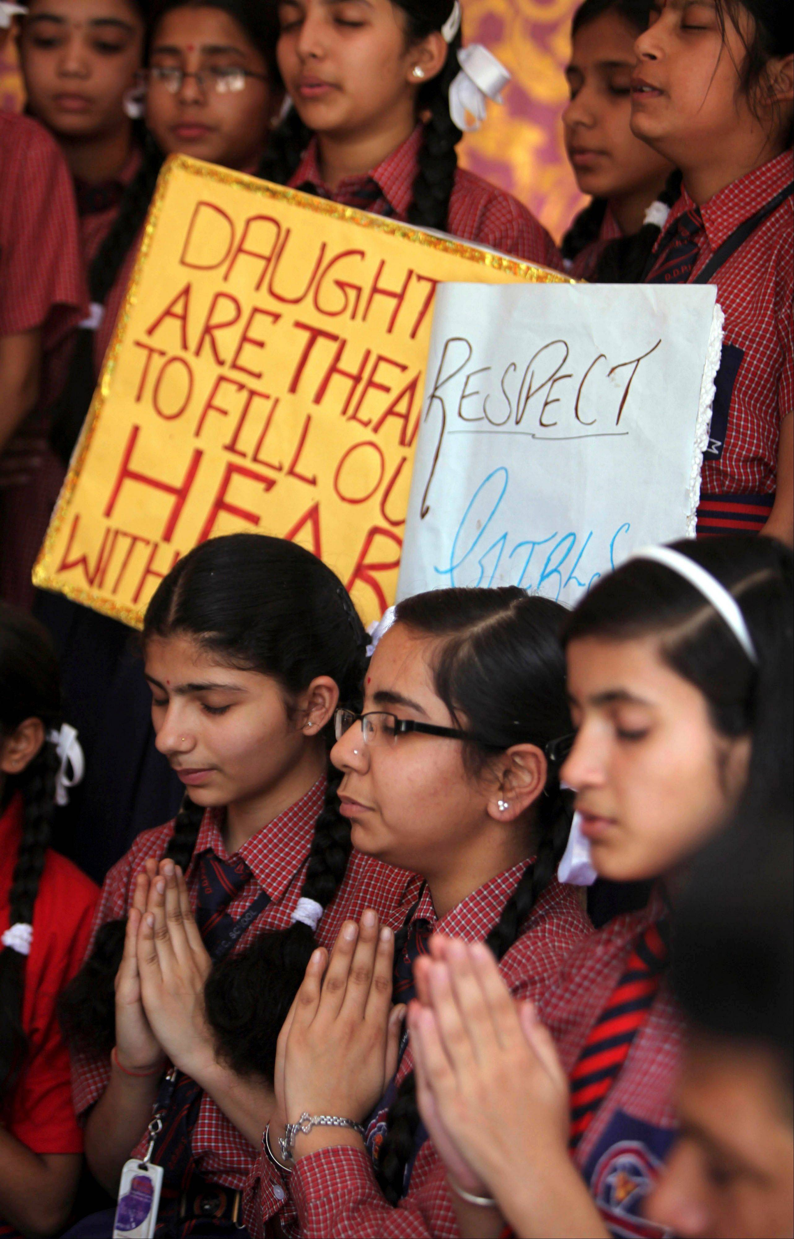 Indian schoolgirls offer prayers for the speedy recovery of a 5-year-old girl who was raped and tortured in New Delhi, at Dewan Devi Public School in Jammu, India, on Monday. A second suspect was arrested Monday in the rape of the girl, who New Delhi police say was left for dead in a locked room, a case that has brought a new wave of protests against how Indian authorities handle sex crimes.