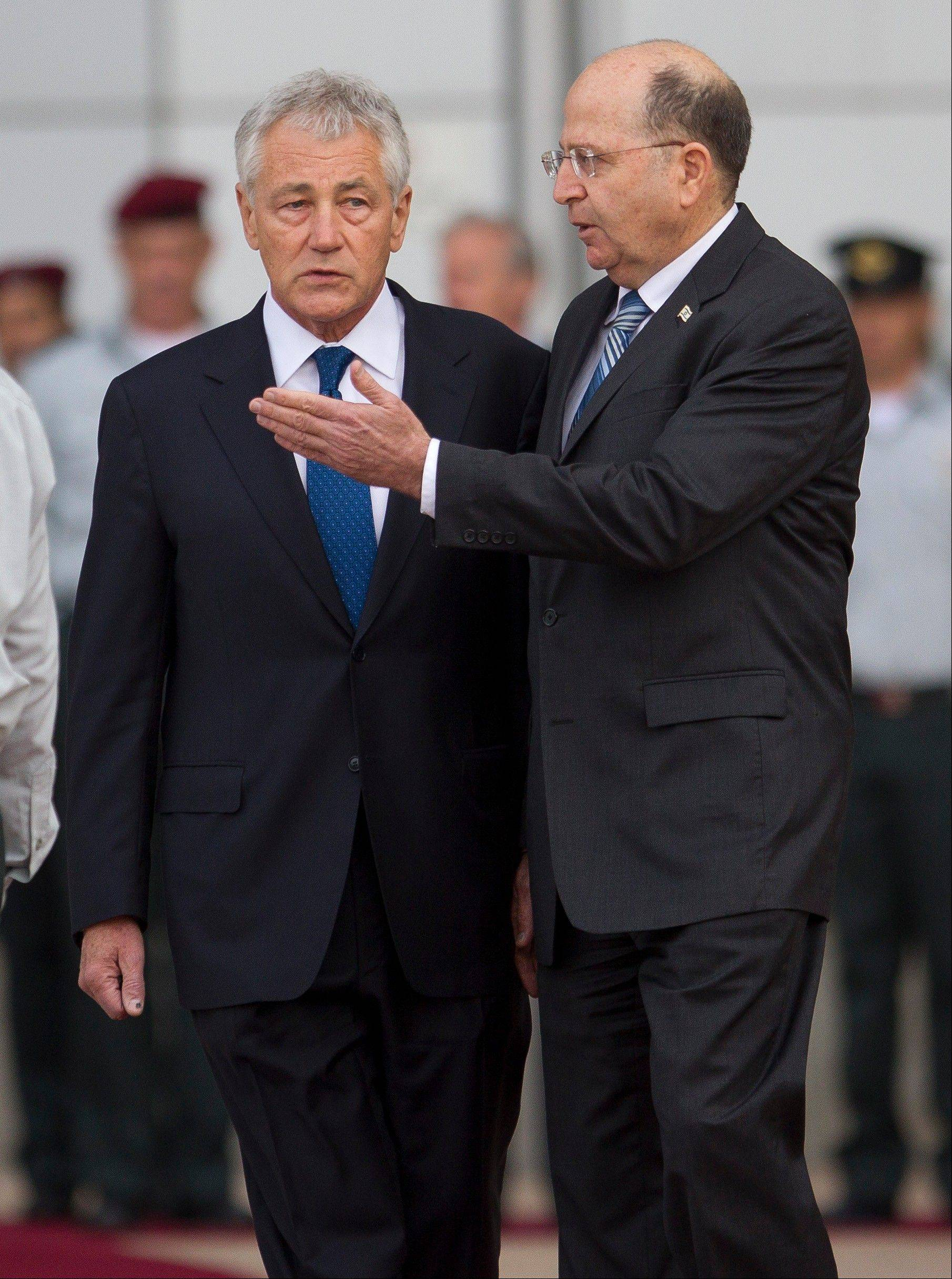 U.S. Defense Secretary Chuck Hagel, left, reviews an honor guard with Israel�s Defense Minister Moshe Yaalon in Hakirya military base in Tel Aviv, Israel, Monday.