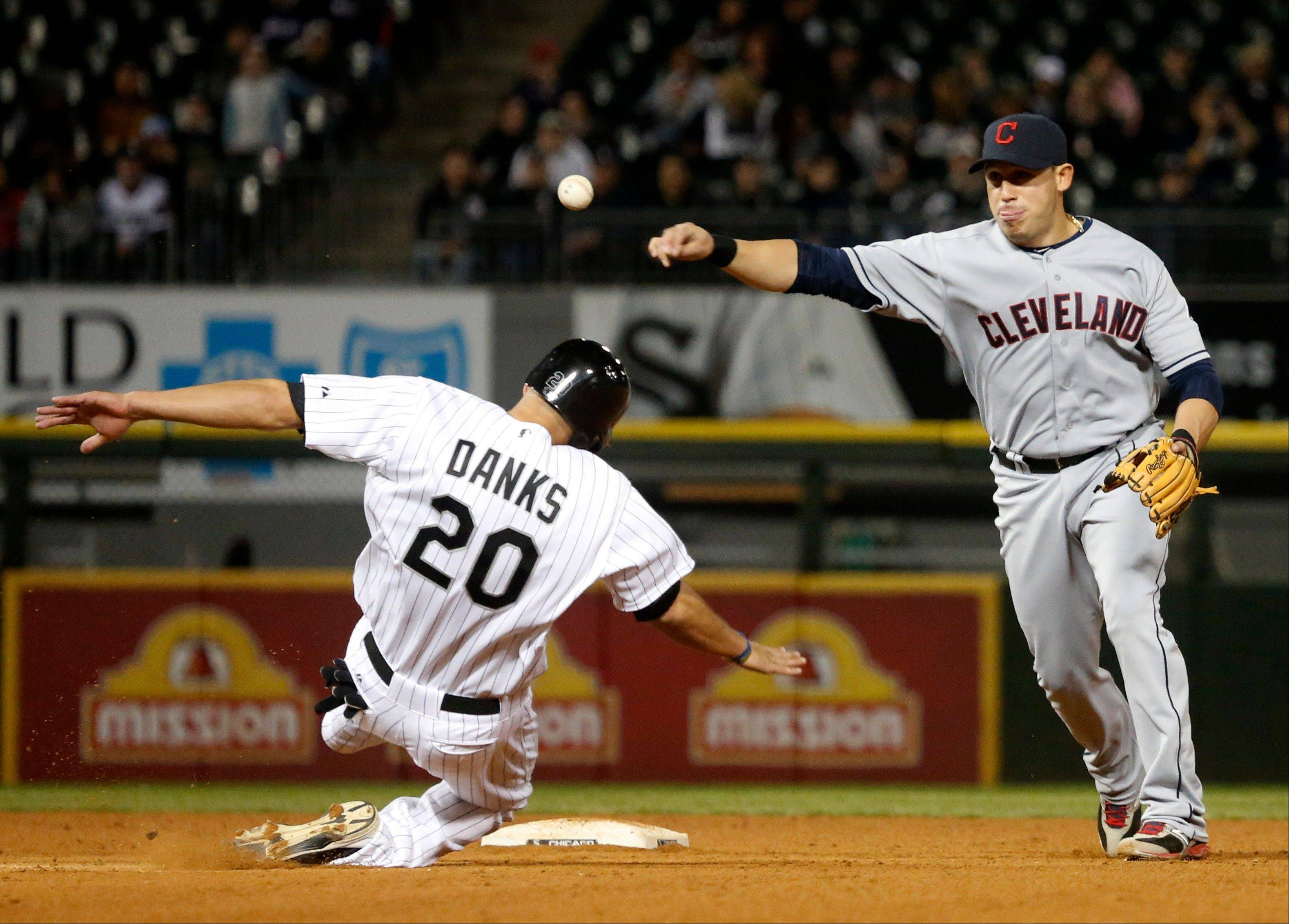 Cleveland shortstop Asdrubal Cabrera turns a double play, forcing Chicago�s Jordan Danks at second and getting Alejandro De Aza at first, during the seventh inning Monday at U.S. Cellular Field.