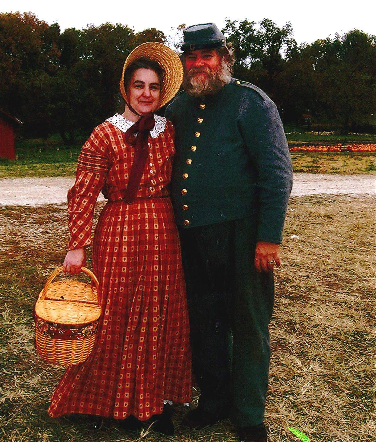 Retiree Pat Healy, left, keeps busy with re-enacting the Civil War with her husband, Rich Healy, right, with the 154th Tennessee Civil War re-enactment group. The pair re-enact Malinda Brunetta Moon, and her husband Larking Moon, an actual member of the regiment 150 years ago.