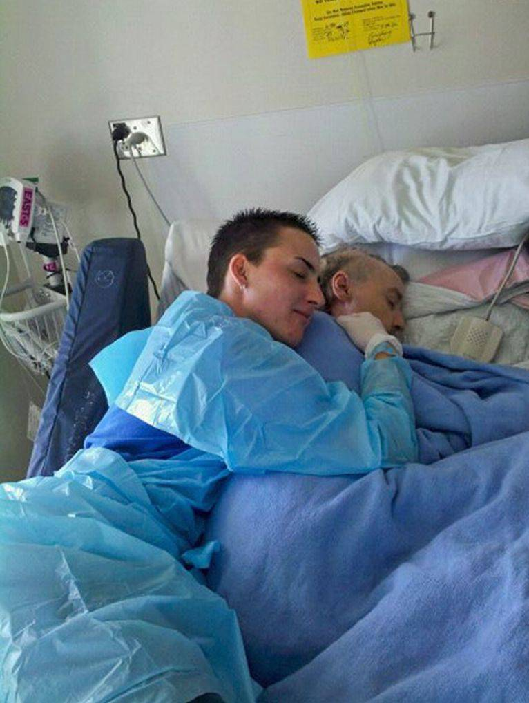 Janet Bradley cuddles with her mom, Terri Bradley, after Terri's final surgical procedure.