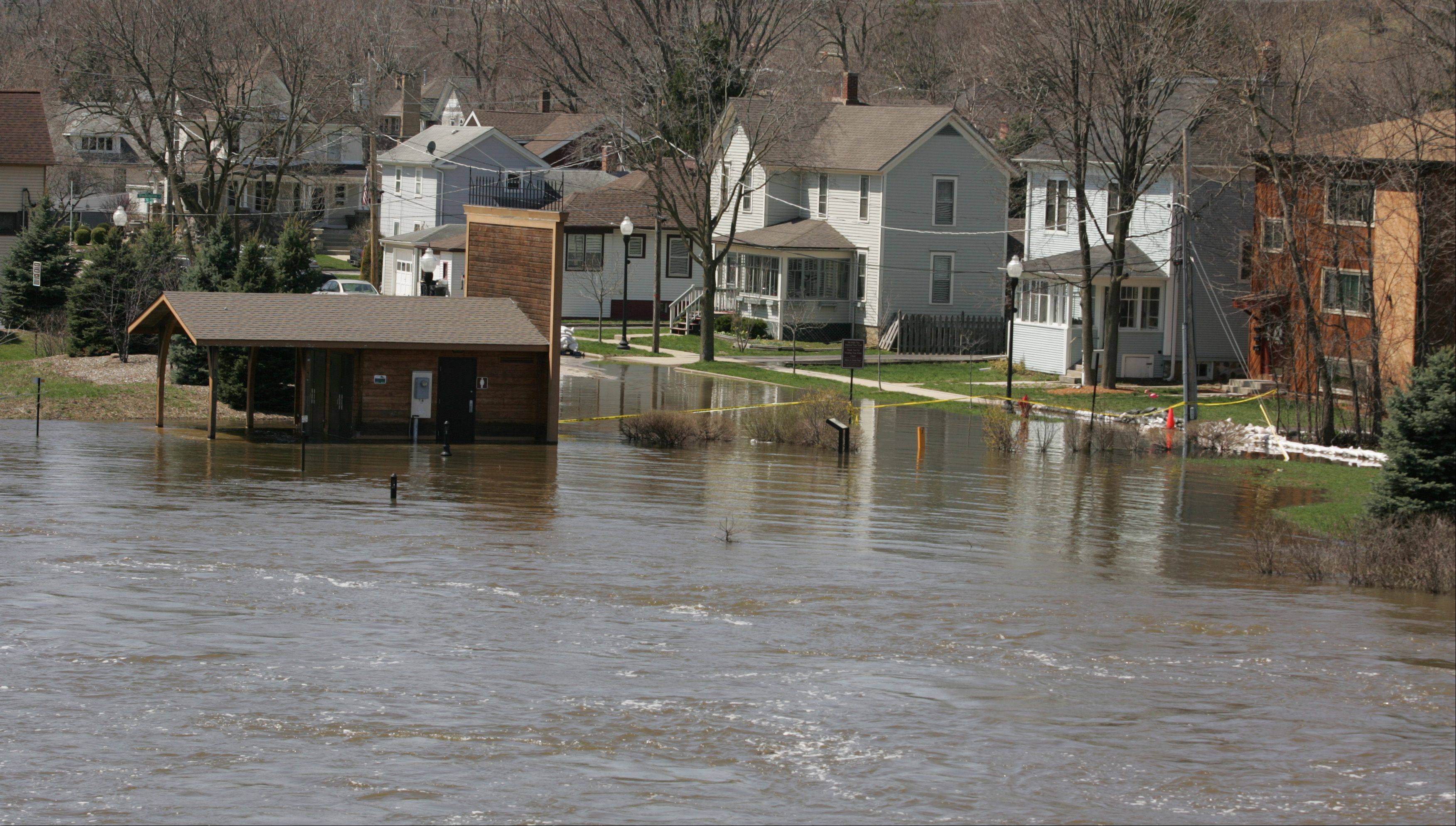 Cornish Park in Algonquin, and several homes south of it, remain inundated with floodwaters from the Fox River Monday morning. Several streets remain closed in the village.