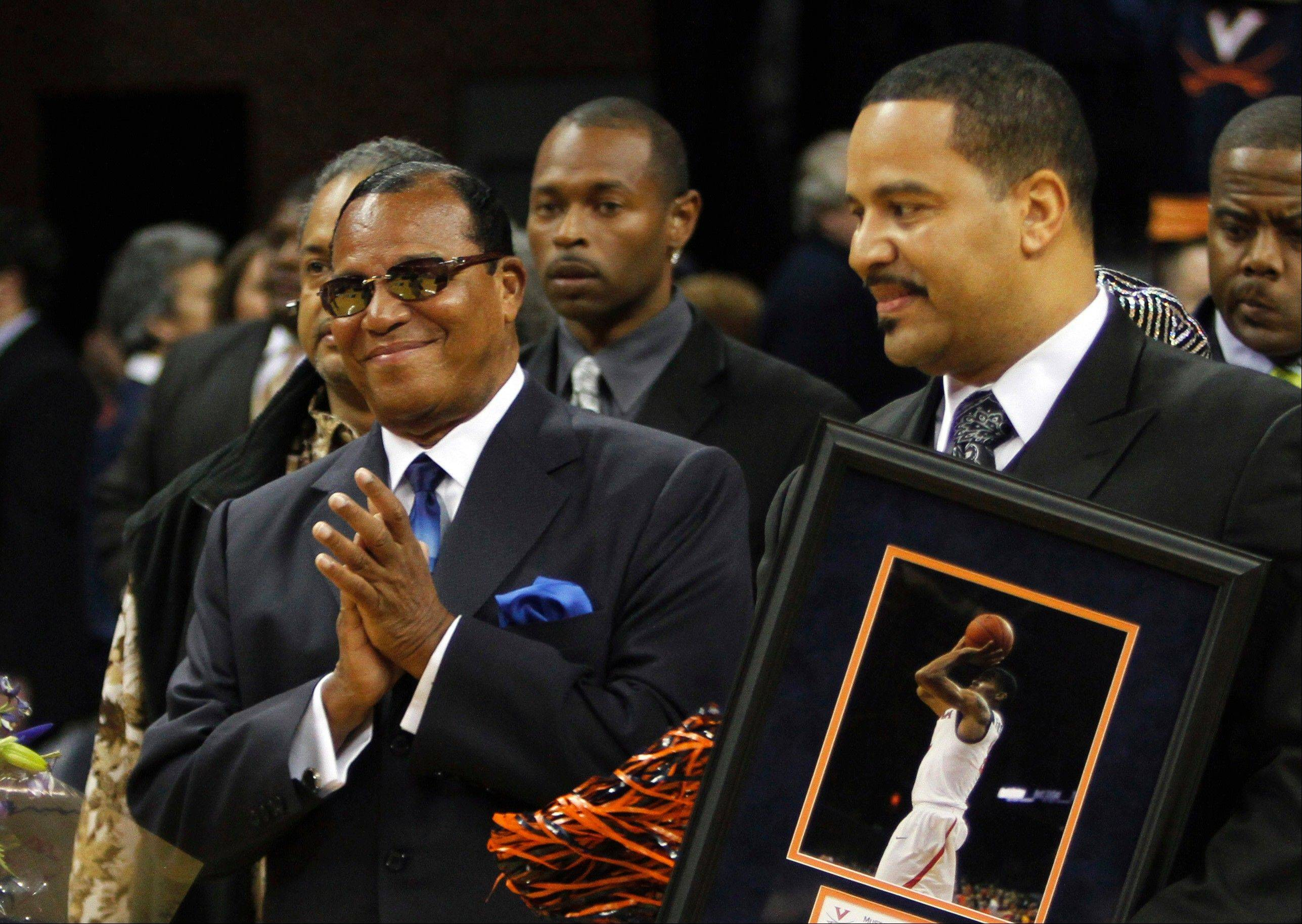 Nation of Islam Minister Louis Farrakhan, left, and son Mustapha Farrakhan attend a ceremony in 2011 honoring University of Virginia seniors, including Mustapha's son, at a college basketball game.