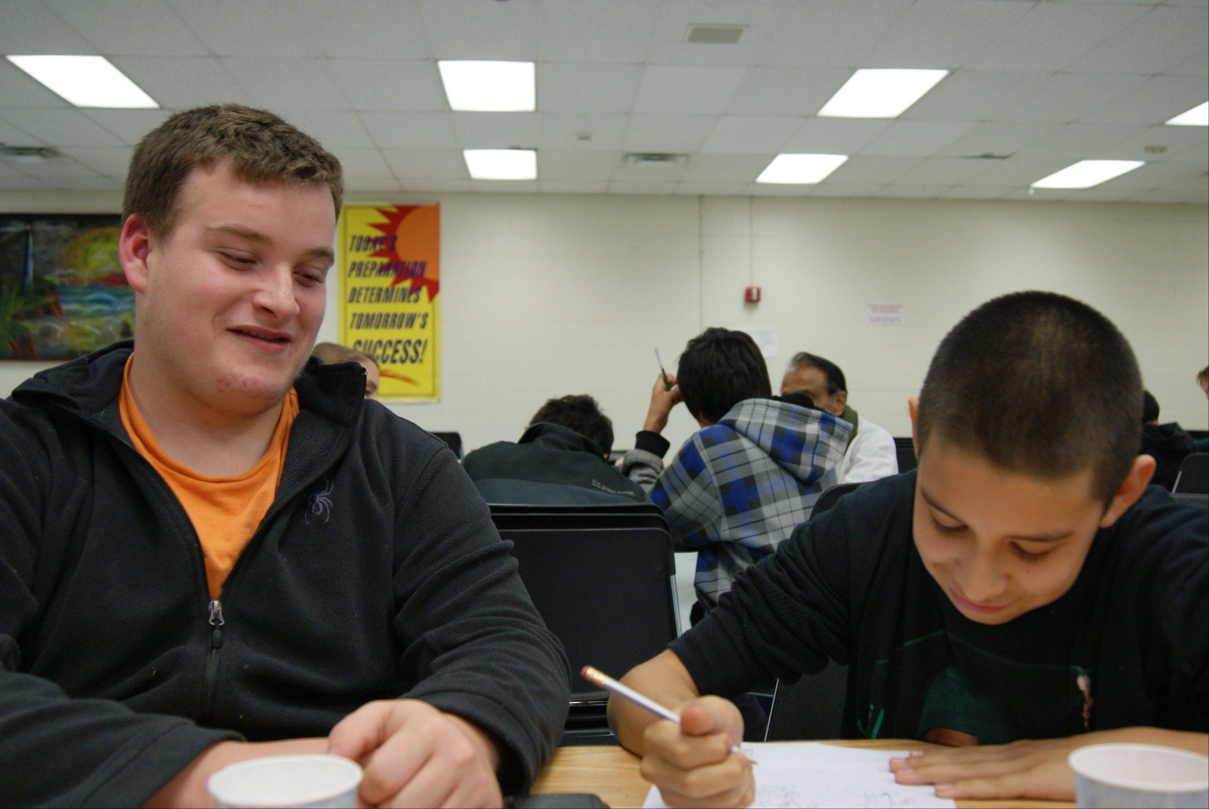Buffalo Grove High School senior Michael LaRue was honored by HandsOn Suburban Chicago for his commitment to mentoring students at London Middle School in Wheeling. Here, he works with an eighth-grader last year.