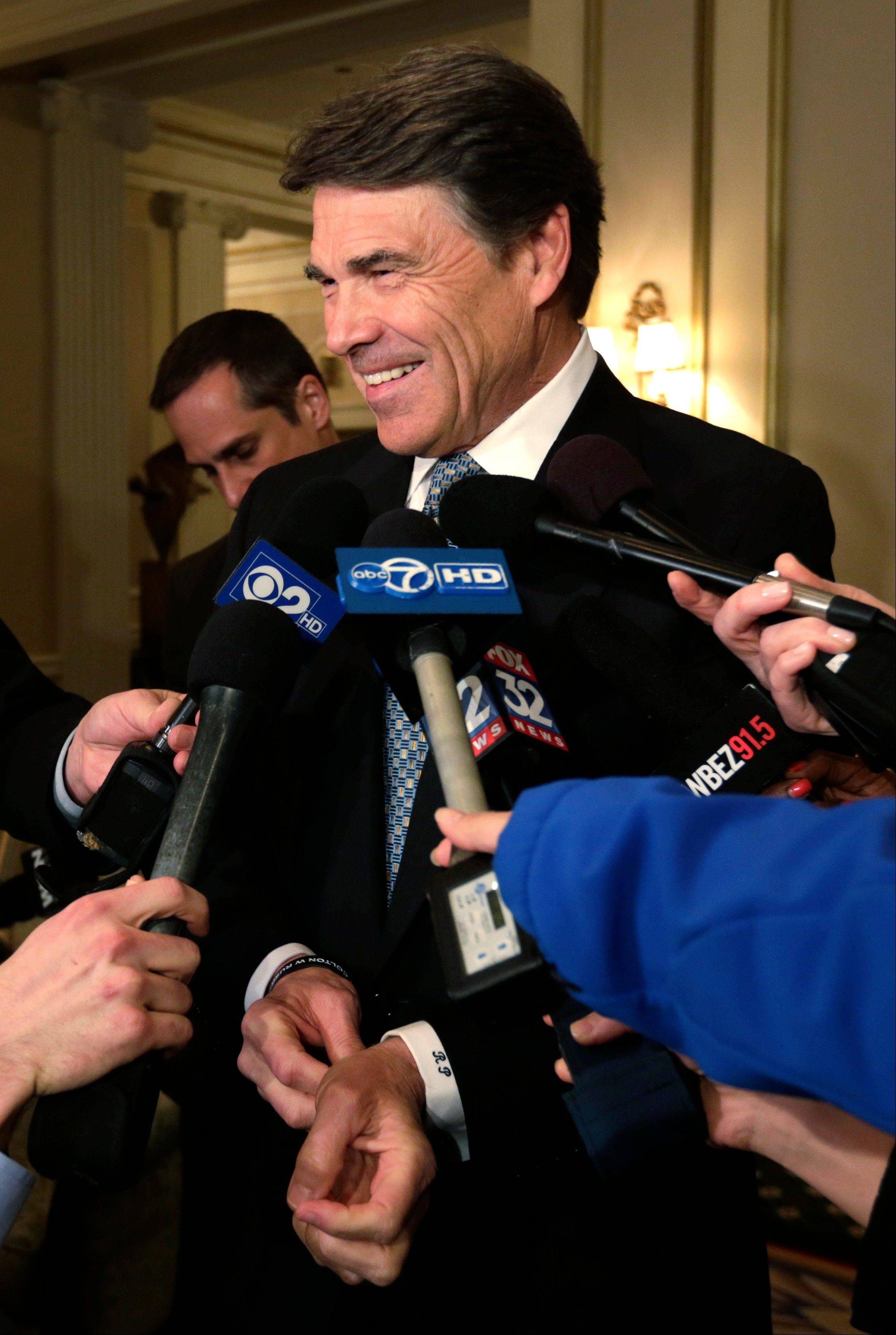 Texas Gov. Rick Perry meets with members media on Monday in Chicago as he visits Illinois to spark competition by luring businesses away from the state. In promoting his state's business environment, Perry says Texas is cheaper and has less regulation.