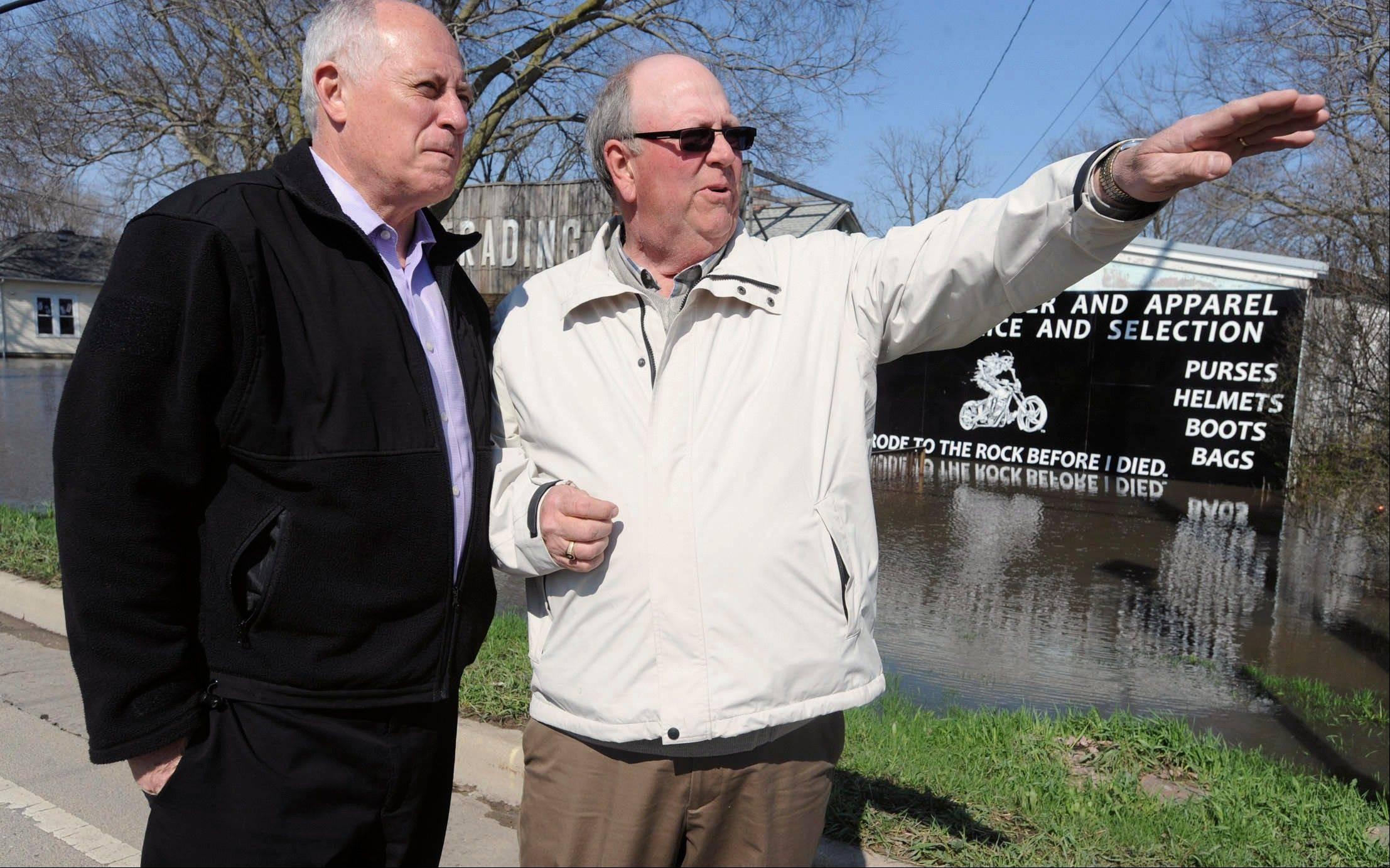 Illinois Gov. Pat Quinn, left, and Utica Mayor Fred Esmond inspect flood damage Sunday during a walking tour in downtown Utica, Ill. Quinn on Sunday declared more counties disaster areas, making a total of 44 in Illinois.