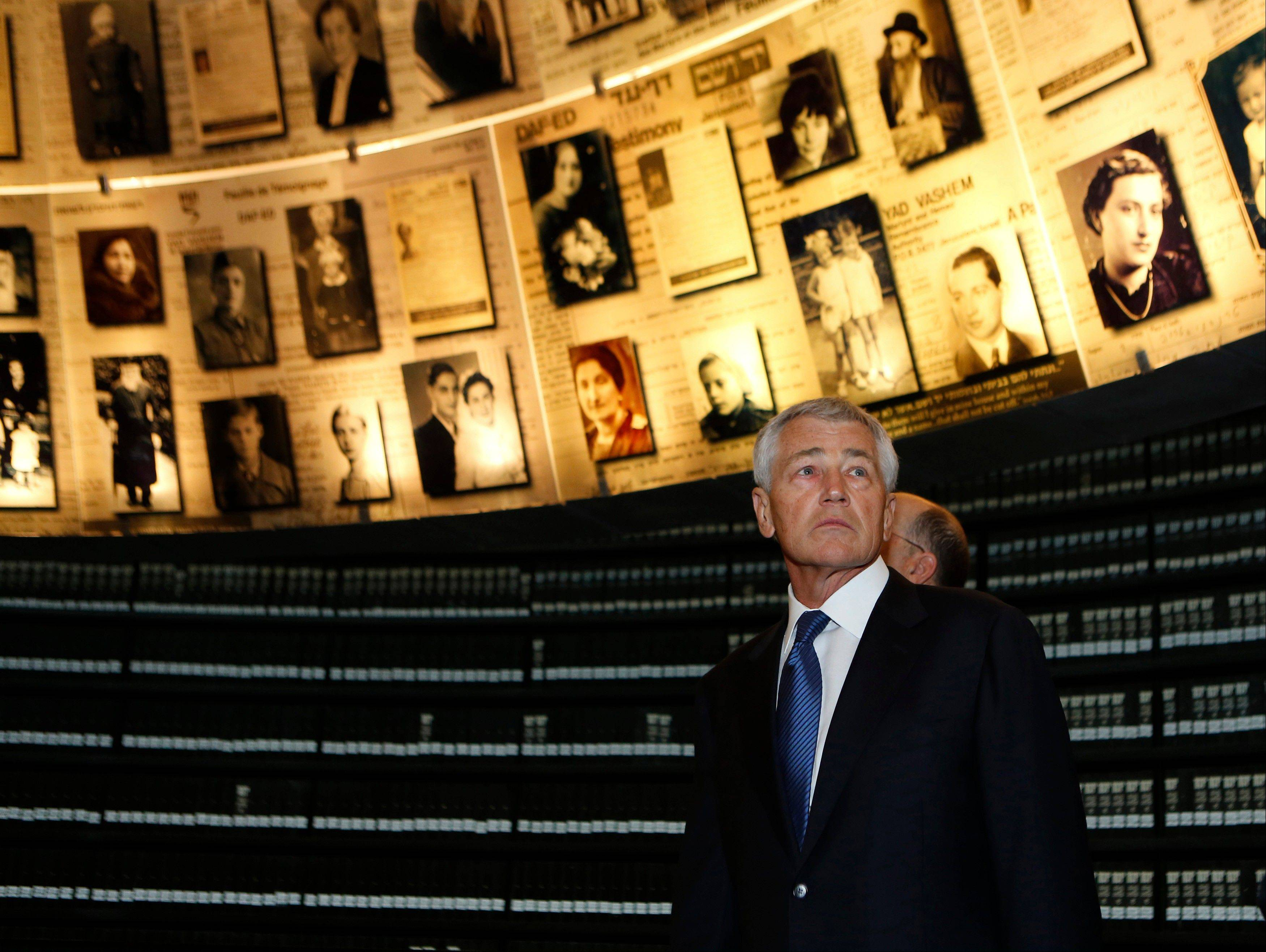 U.S. Secretary of Defense Chuck Hagel looks at pictures of Jews killed in the Holocaust during a visit to the Hall of Names at Yad Vashem's Holocaust History Museum in Jerusalem, Israel, on Sunday.