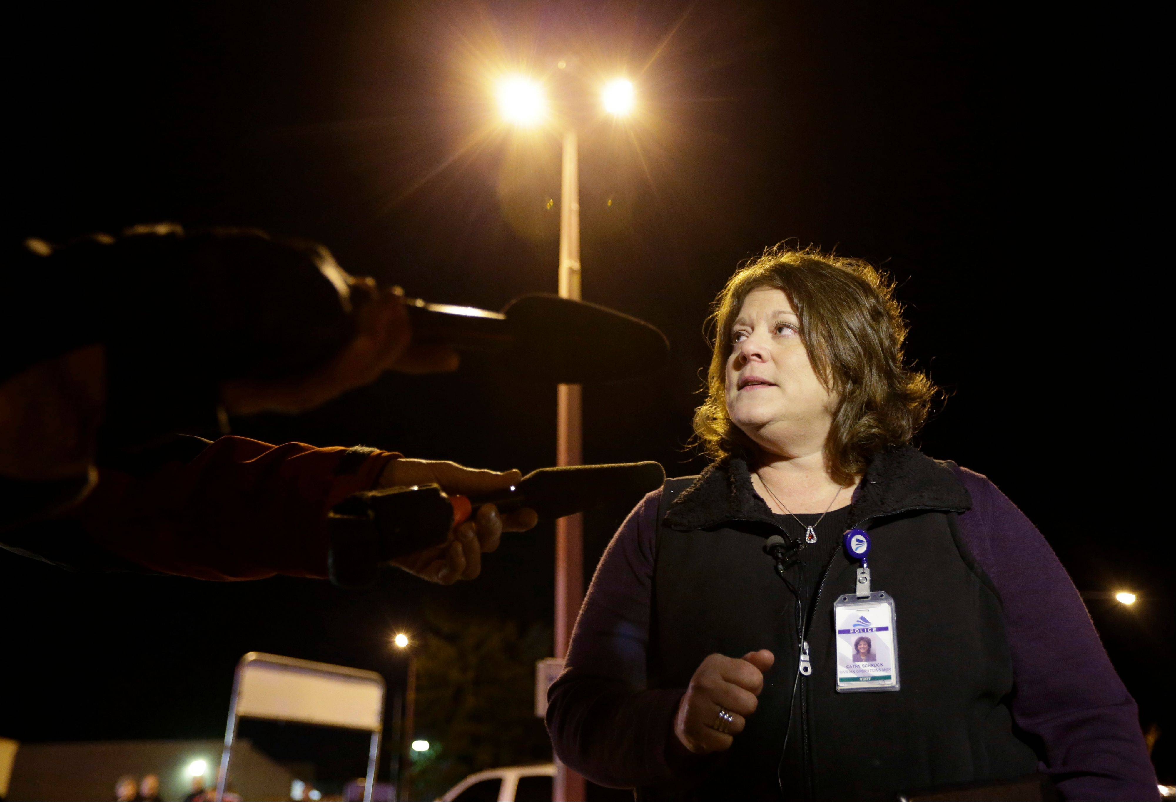 Federal Way Police spokeswoman Cathy Schrock talks to reporters about an overnight shooting that she said left five people dead Monday at an apartment complex in Federal Way, Wash.