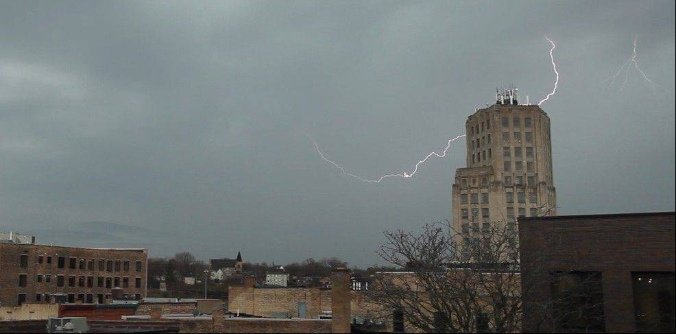 Streaks of lightning flash across the sky over Elgin Wednesday morning as thunderstorms roll through the northwest suburbs.