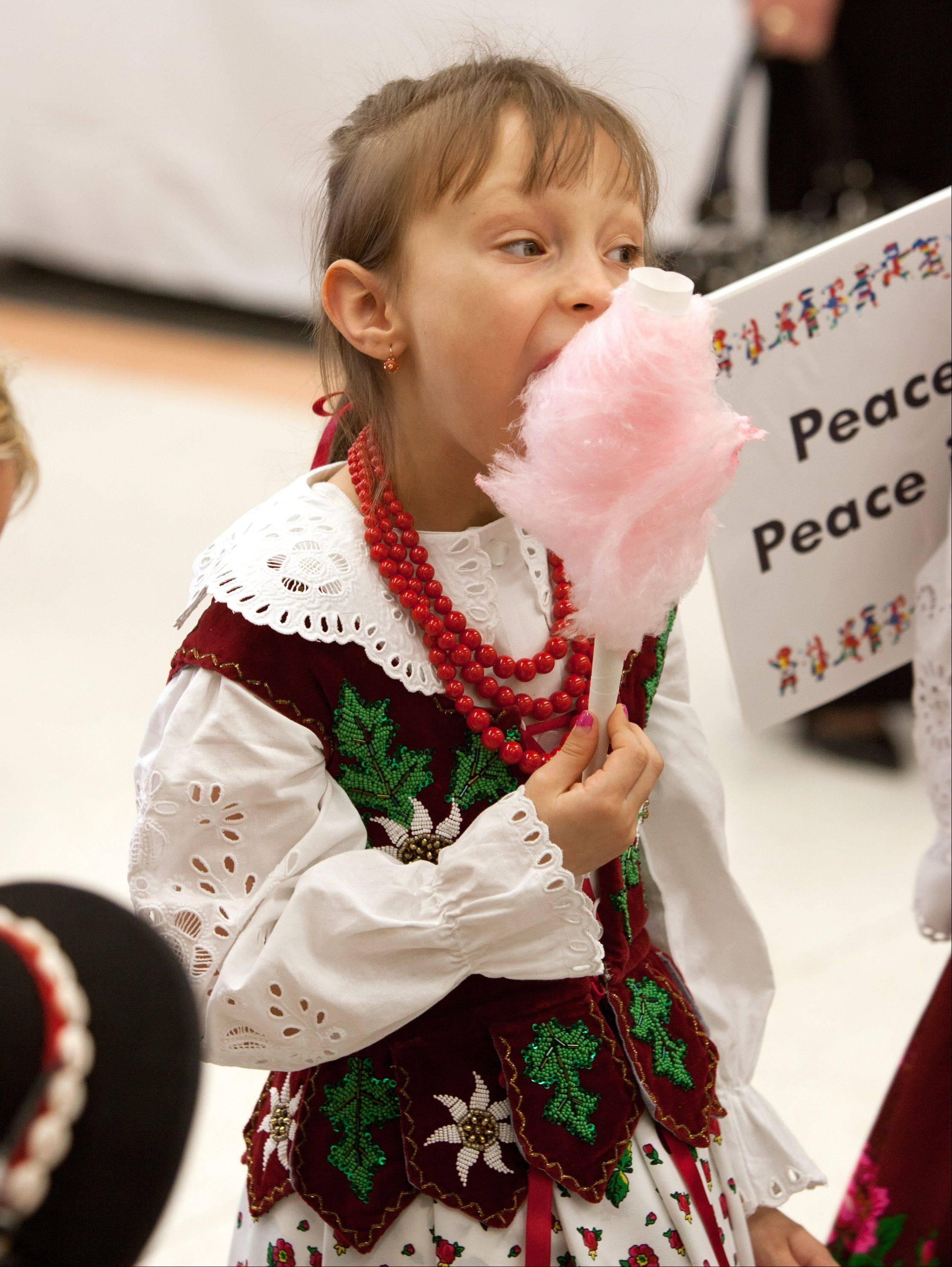 Wioletta Ligas of Hickory Hills takes a candy break before dancing at the Turkish American Cultural Alliance and Turkish Friends of Naperville's International Children's Day event at Owen Elementary School.
