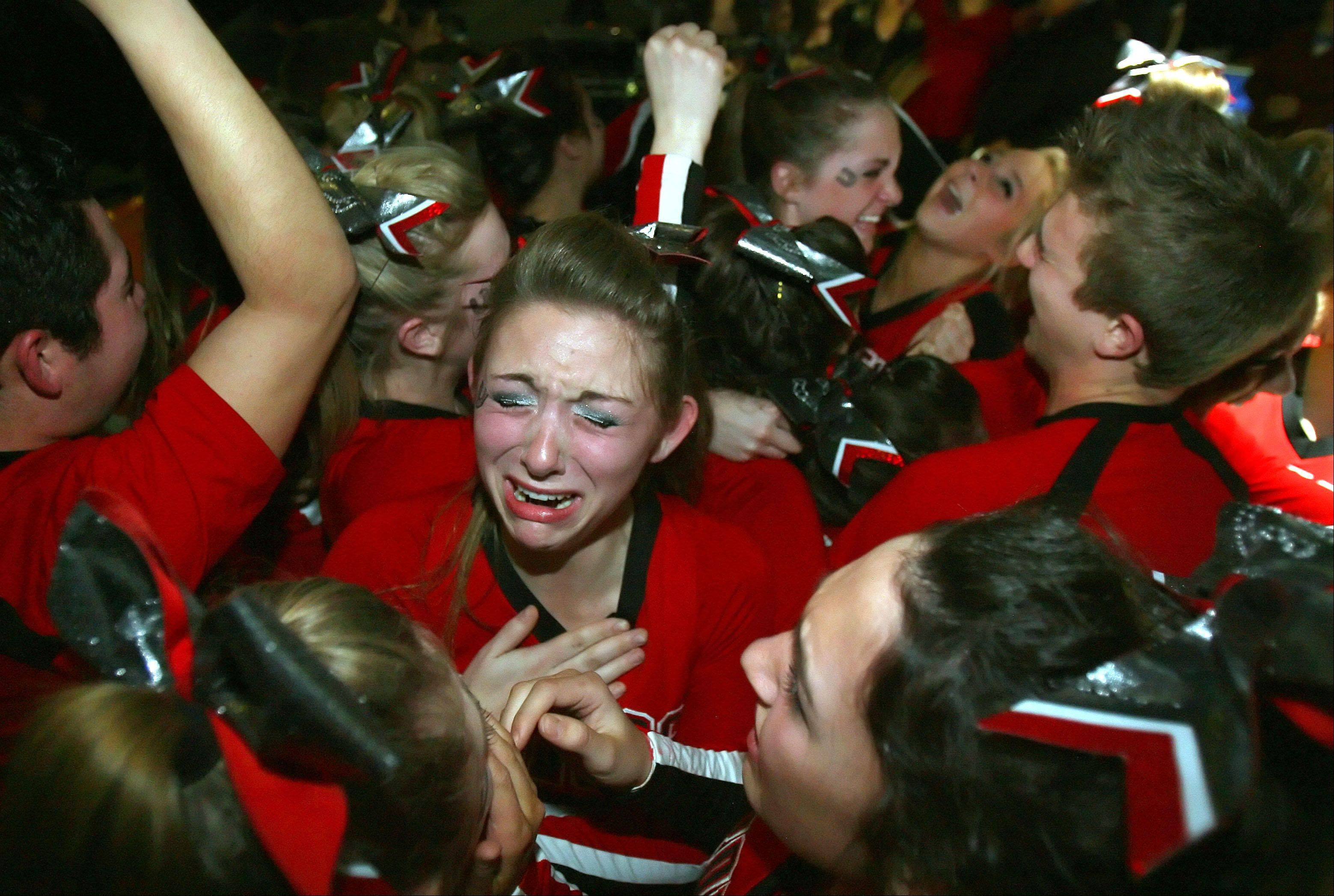 Barrington High School's large co-ed team celebrate after winning 2nd place in the IHSA Competitive Cheerleading finals in Bloomington.