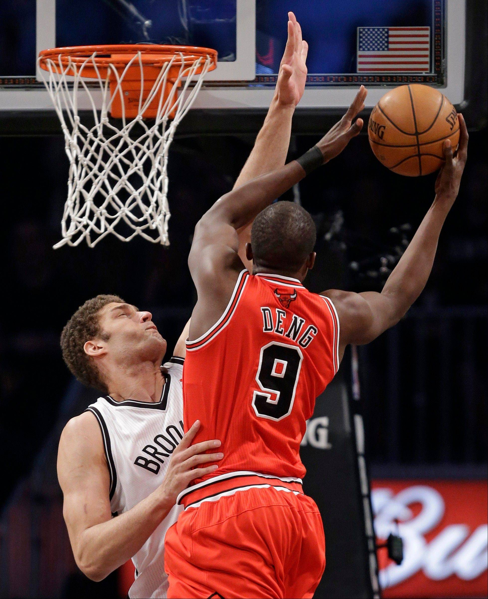 Brooklyn Nets center Brook Lopez defends as Bulls forward Luol Deng goes up for a layup Monday in the first half of Game 2 of their first-round NBA basketball playoff series in New York.