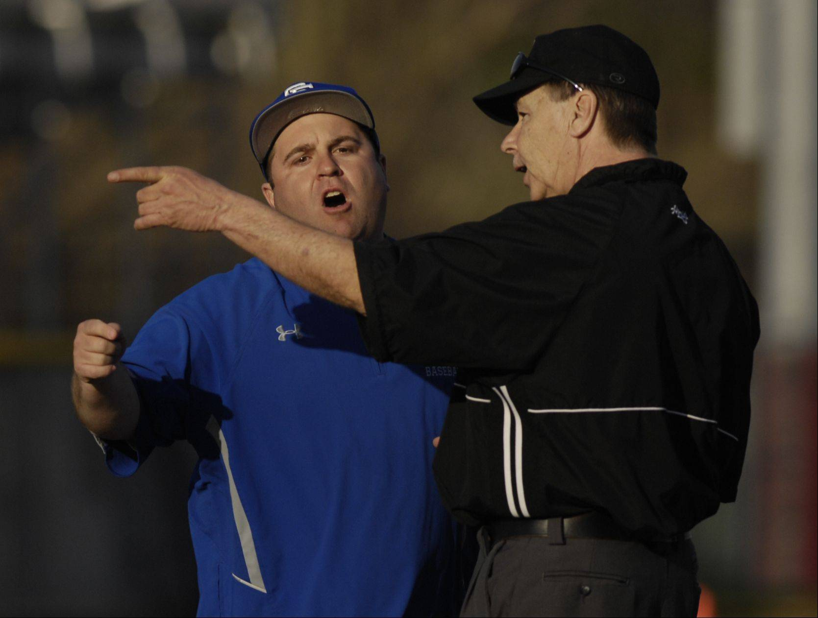 St. Francis head coach Rich Janor argues a call during their loss to Montini, Monday.
