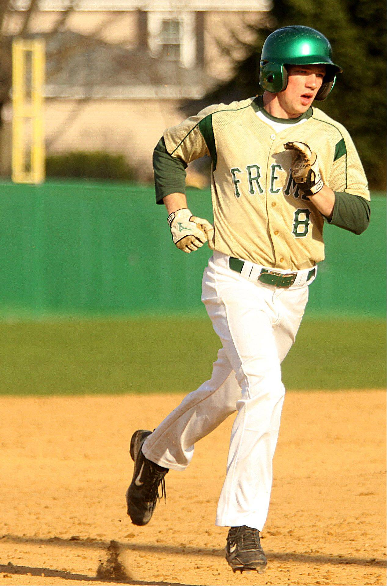 Fremd's Sam Beutler trots toward third base after hitting a 3-run homer against Schaumburg in Palatine on Monday.