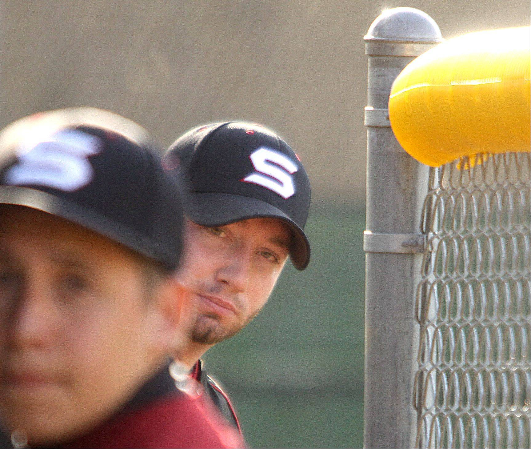 Schaumburg coach Cal Seely keeps an eye on the action against Fremd on Monday in Palatine.