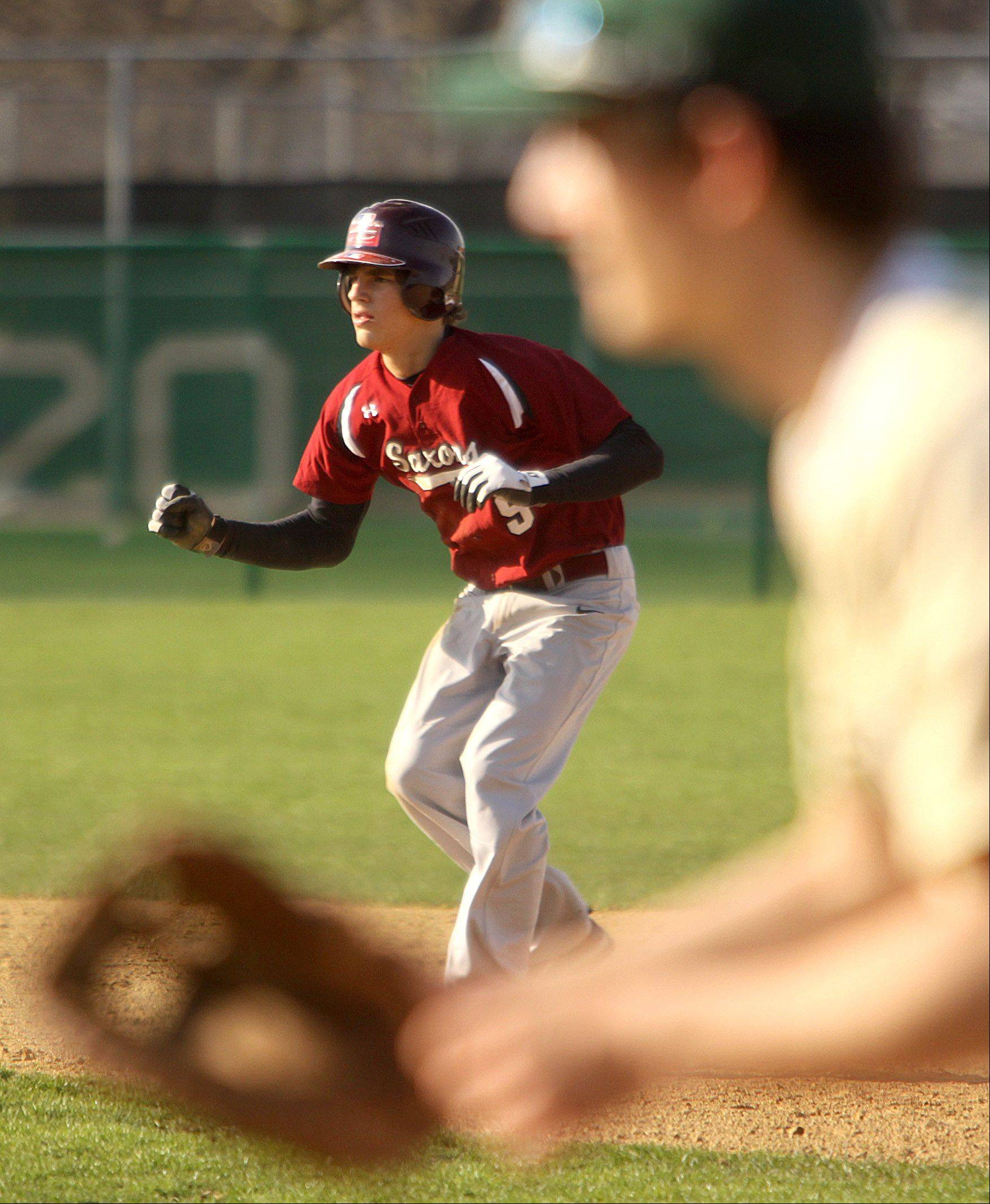 Schaumburg's Dylan Roskin leads off of second base against Fremd in Palatine on Monday.