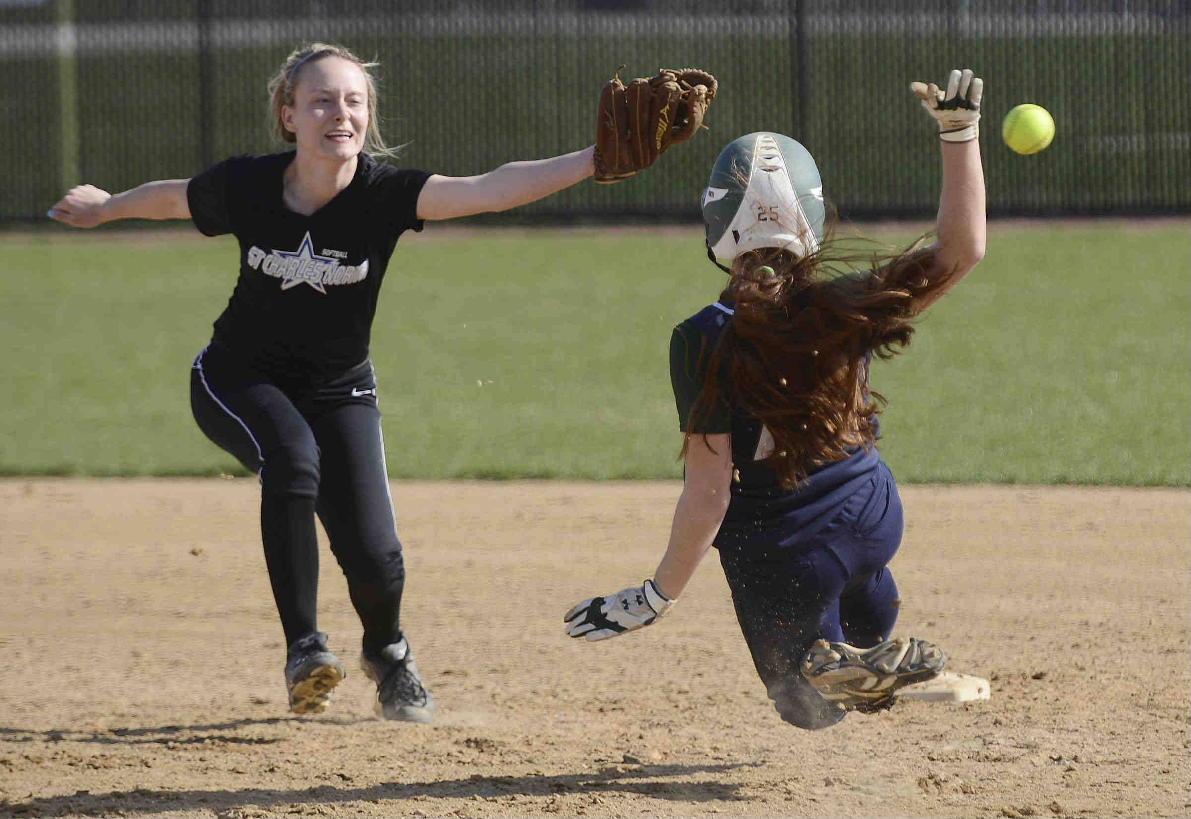 St. Charles North shortstop Mickey Goetz can't reach a wide throw as Bartlett's Kayla Haberstich steals second base Monday in St. Charles. It didn't matter as the batter had struck out on the pitch for the third out of the first inning.