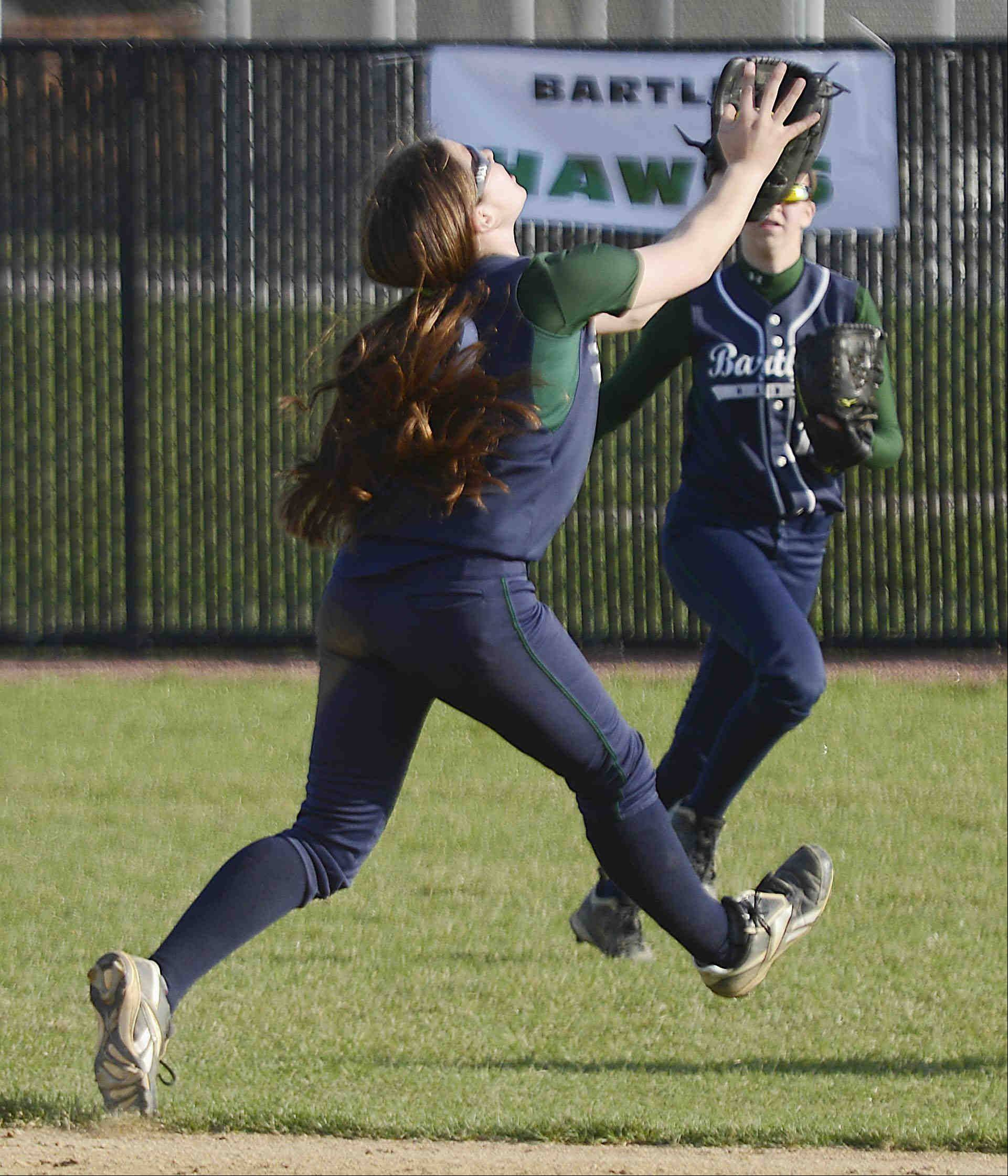 Bartlett shortstop Kayla Haberstich makes and over-the-shoulder catch on a pop up by St. Charles North's Abby Howlett for the first out of the seventh inning Monday in St. Charles.