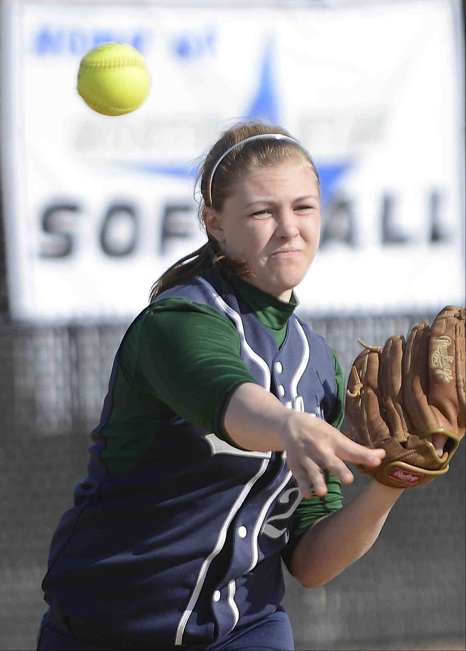 Bartlett starting pitcher Holly Pagan turns and throws to first against St. Charles North Monday in St. Charles.