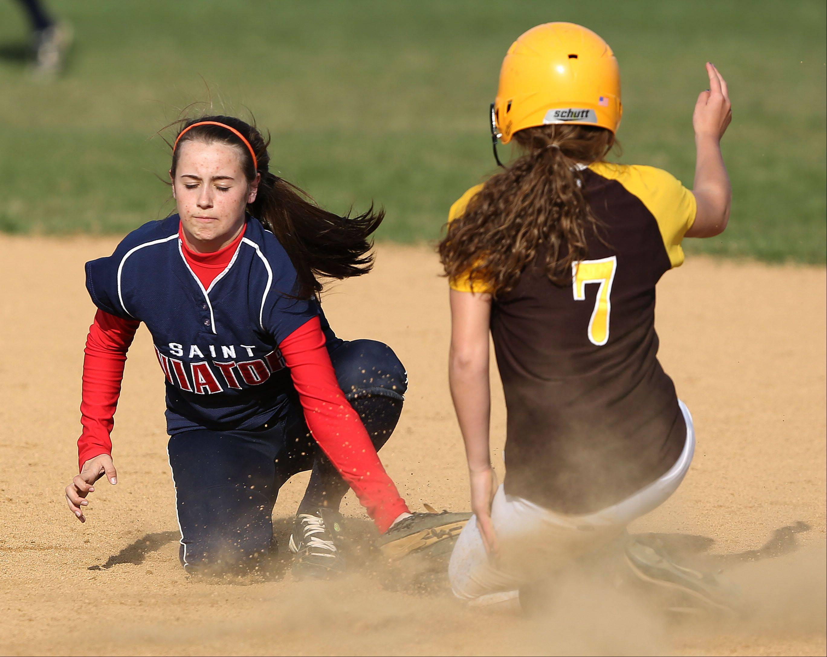St. Viator' Tess Kaiser tries to put a tag on Carmel's Sam Melillo on Monday in Mundelein.