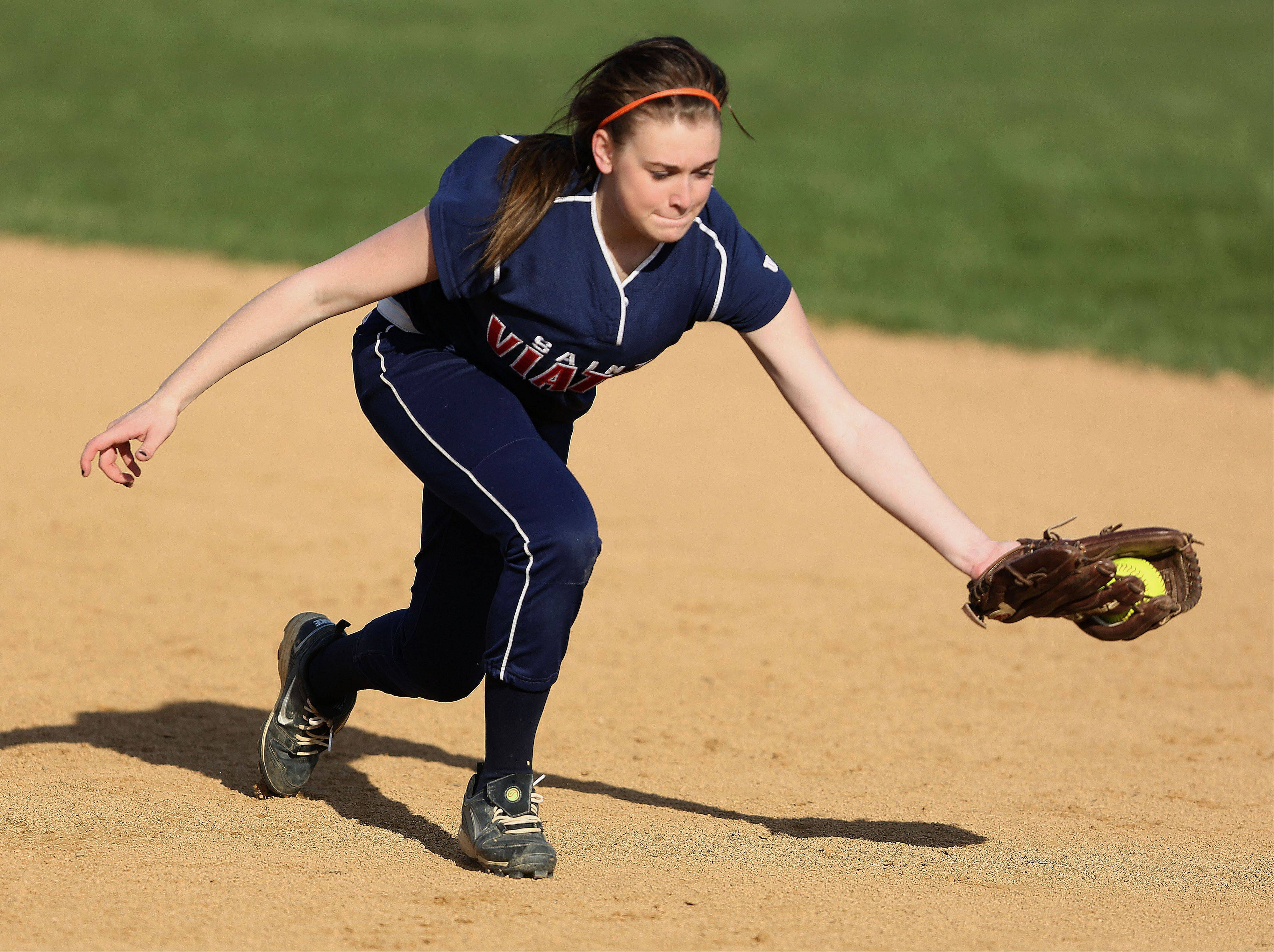 St. Viator' Taylor Noll tracks down a groundball Monday at Carmel Catholic High School.
