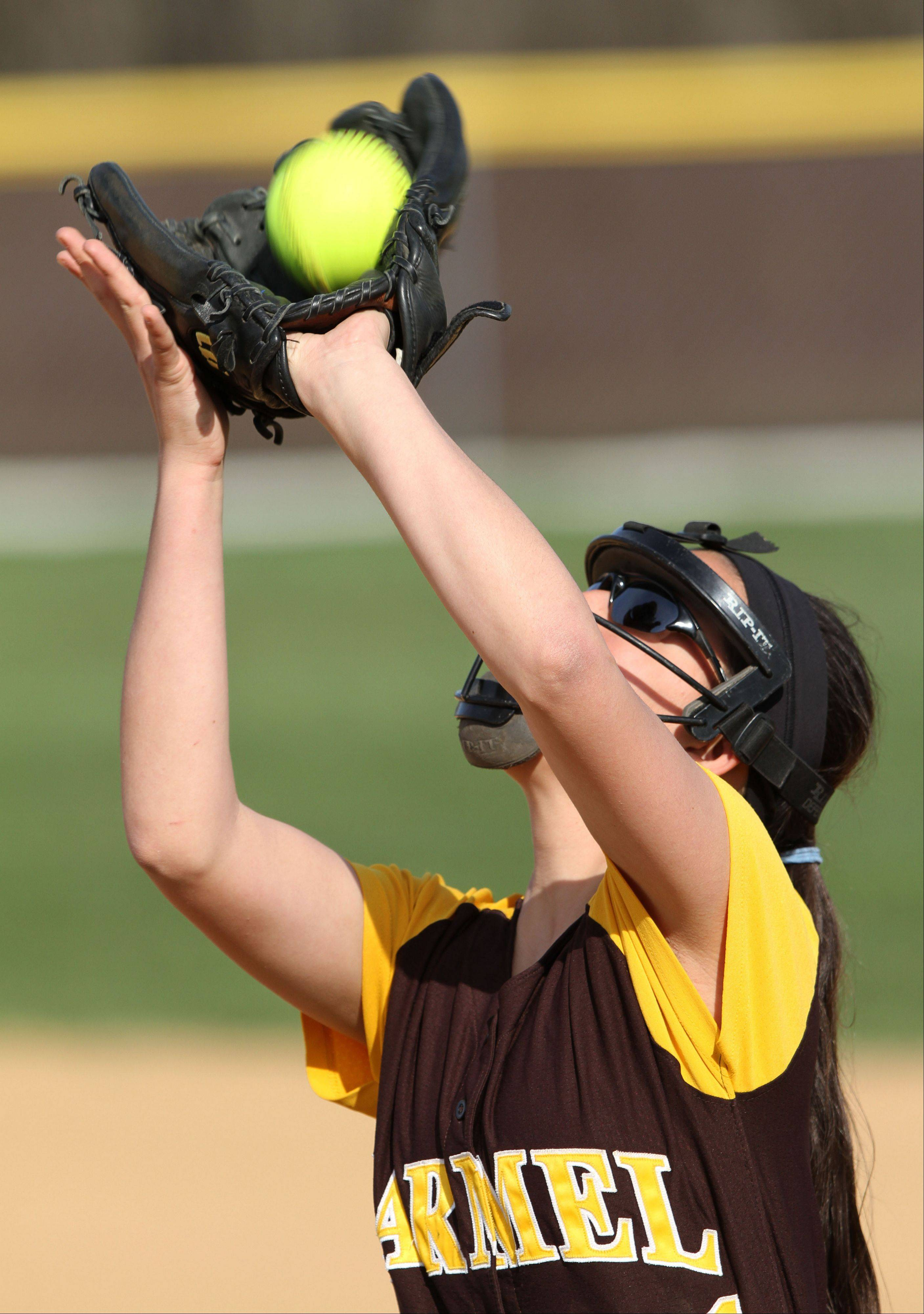 Carmel's Annie Poll makes a catch in the infield against St. Viator on Monday in Mundelein.