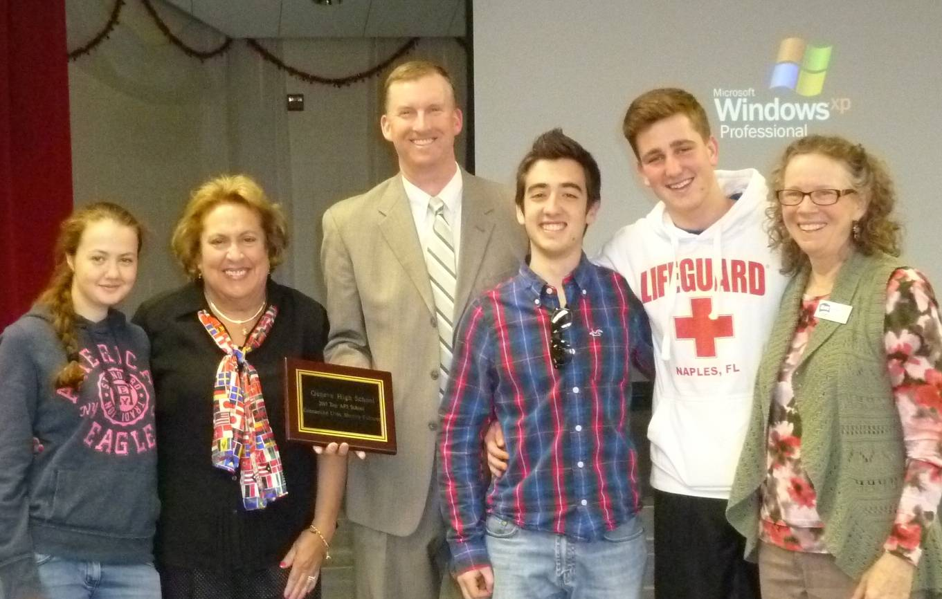 Three of the four current AFS students helped to present the plaque. Pictured from left to right are  Dasha Khodak from Ukraine hosted by the Leiderman family, Guidance Chair Mary Jane Johnson, Principal Tom Rogers, Matteo Boi from Italy hosted by the Powelson family, Guillaume Rey from Switzerland hosted by the Burgess family, Robbin Lang, AFS volunteer. Victoria Zapf from Germany hosted by the Kuyawa family is not pictured.