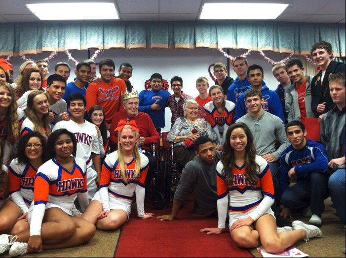 Hoffman Estates High School wrestlers and cheerleaders visit residents at the Alden Poplar Creek Rehabilitation and Health Center on Valentine's Day.