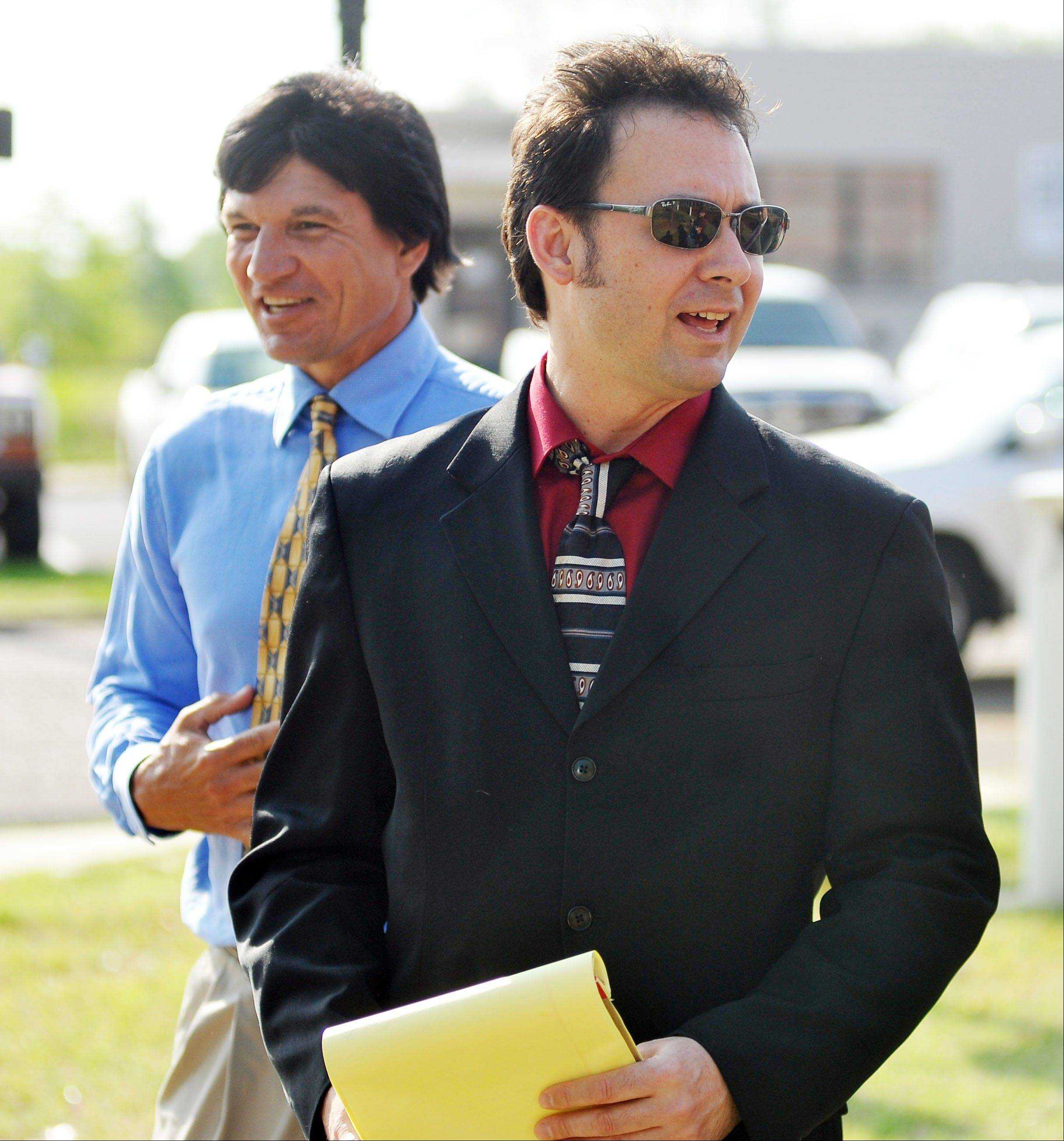 Paul Kevin Curtis, right, who had been in custody under the suspicion of sending letters which tested positive for ricin to President Barack Obama and Sen. Roger Wicker, R-Miss., and his brother Jack Curtis walk to a press conference Tuesday in Oxford, Miss.
