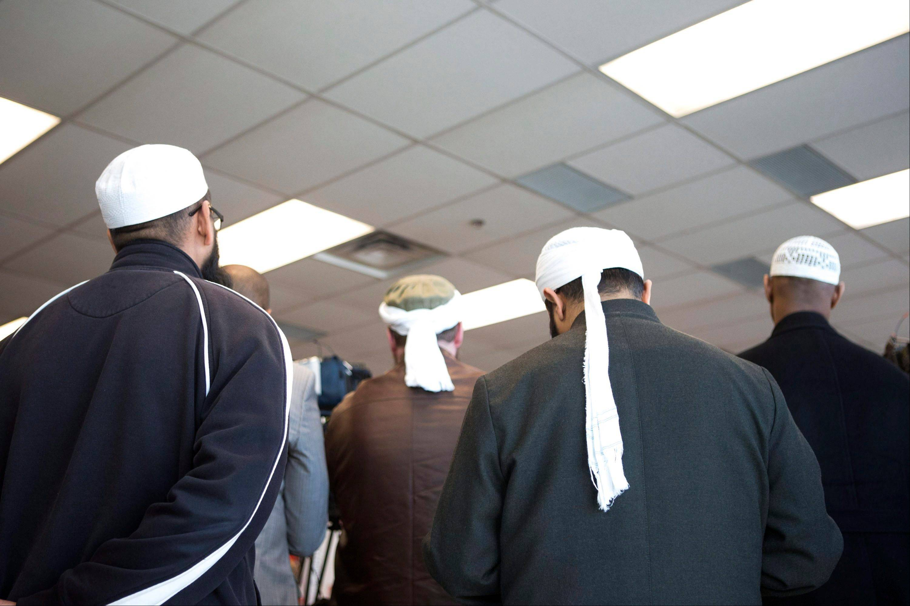 Representatives of Toronto's Islamic community attend a news conference in Toronto as the Royal Canadian Mounted Police announce the arrest of two men accused of plotting a terror attack on rail target, in Toronto, Monday April 22, 2013.