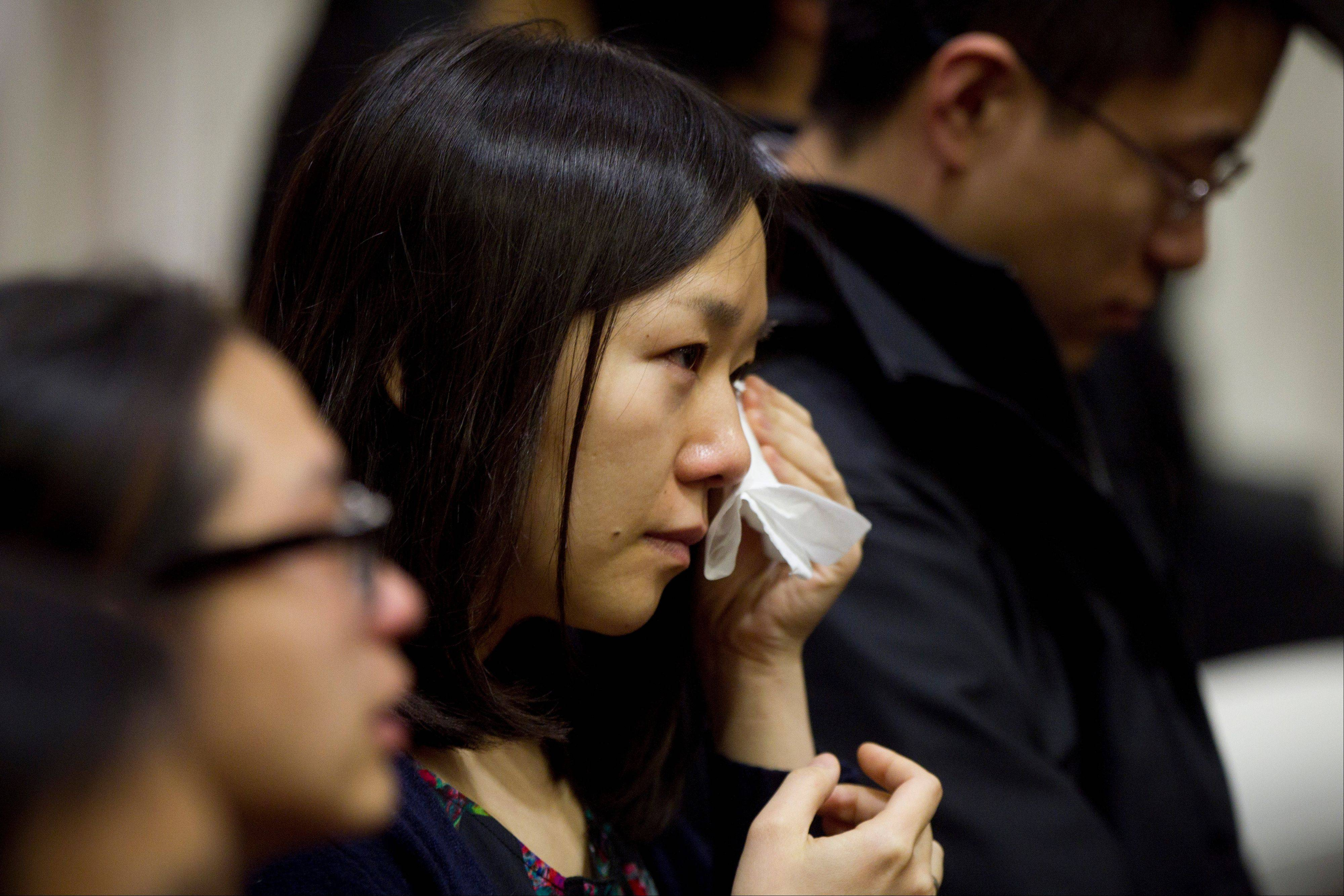 A member of the audience sheds tears during Lu Lingzi's eulogy, delivered by her father, Lu June at Metcalf Hall in Boston University's George Sherman Student Union on Monday, April 22, 2013. Lingzi was killed in the Boston Marathon bombings.