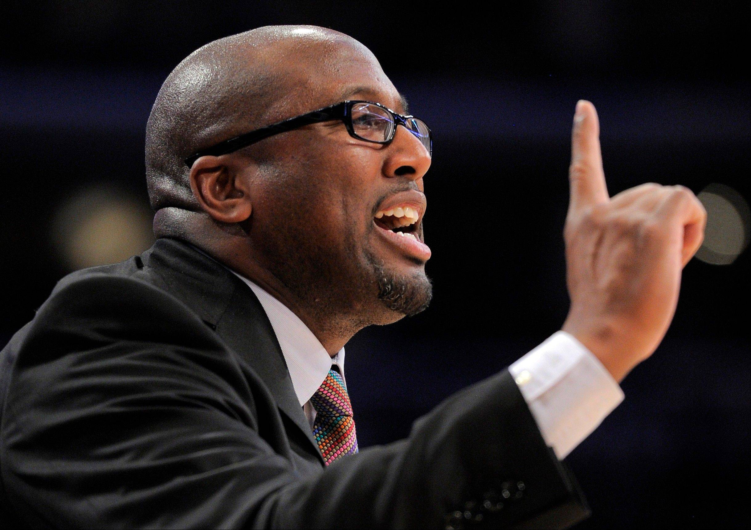 FILE - In this Dec. 25, 2011 file photo, Los Angeles Lakers coach Mike Brown gestures during the second half of the Lakers' NBA basketball game against the Chicago Bulls, in Los Angeles. The Cavaliers intend to speak with former coach Brown about returning to the team. Brown was fired by Cleveland three years ago and replaced by Byron Scott, who was let go by the Cavs on Thursday after he went 64-166 in three seasons _ one of the worst stretches in team history. . (AP Photo/Mark J. Terrill, File)