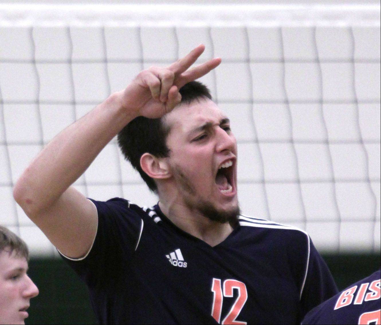 Buffalo Grove's Jose Aguirre offers encouragement to teammates during Tuesday's volleyball game against Elk Grove.