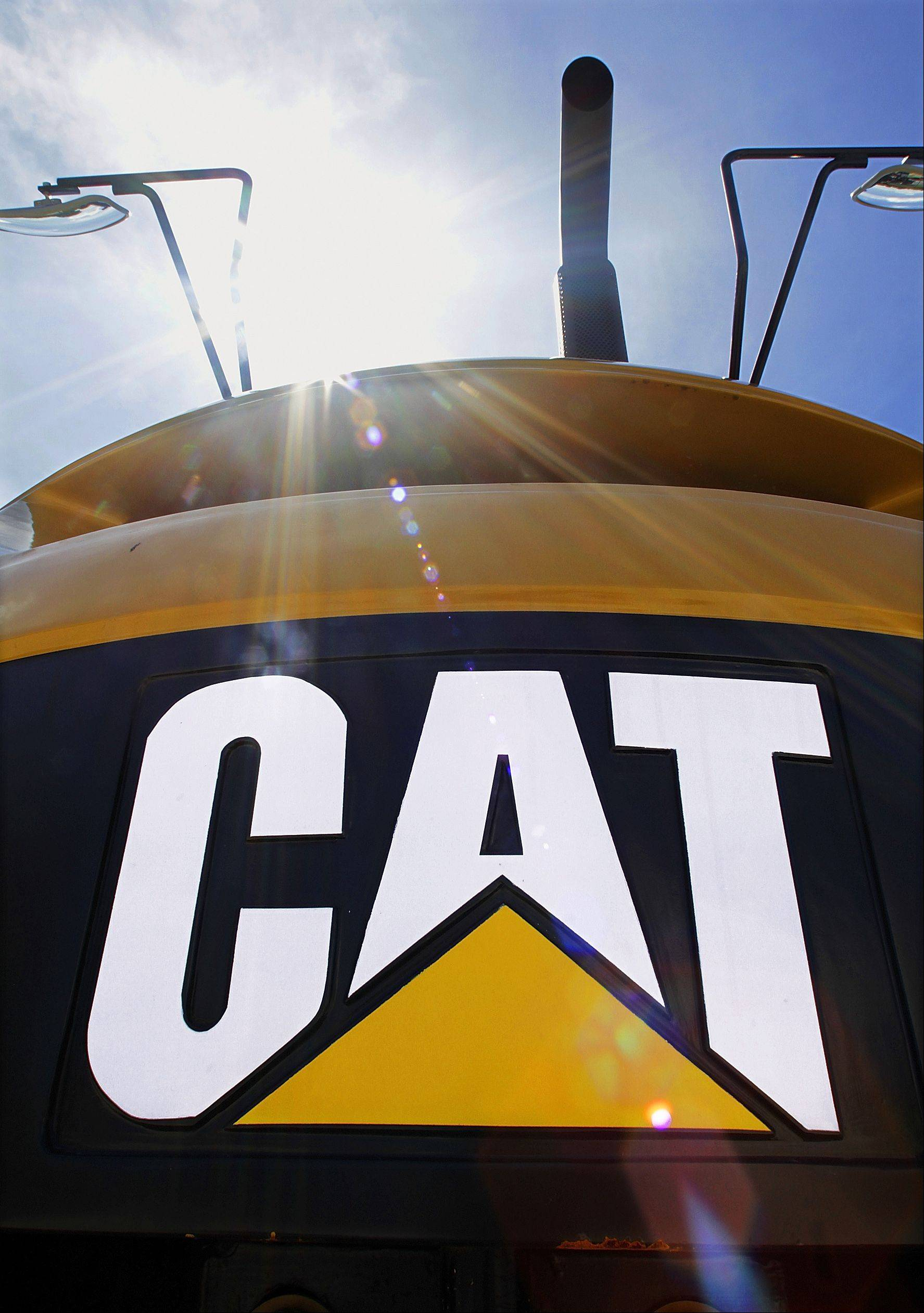 In this July 19, 2010 photo, the Caterpillar logo is displayed on heavy earth moving equipment in Springfield, Ill. Heavy machinery manufacturer Caterpillar said Thursday, July 22, 2010, its second-quarter earnings shot up 91 percent on a big increase in sales of equipment for industries like mining, infrastructure and energy.