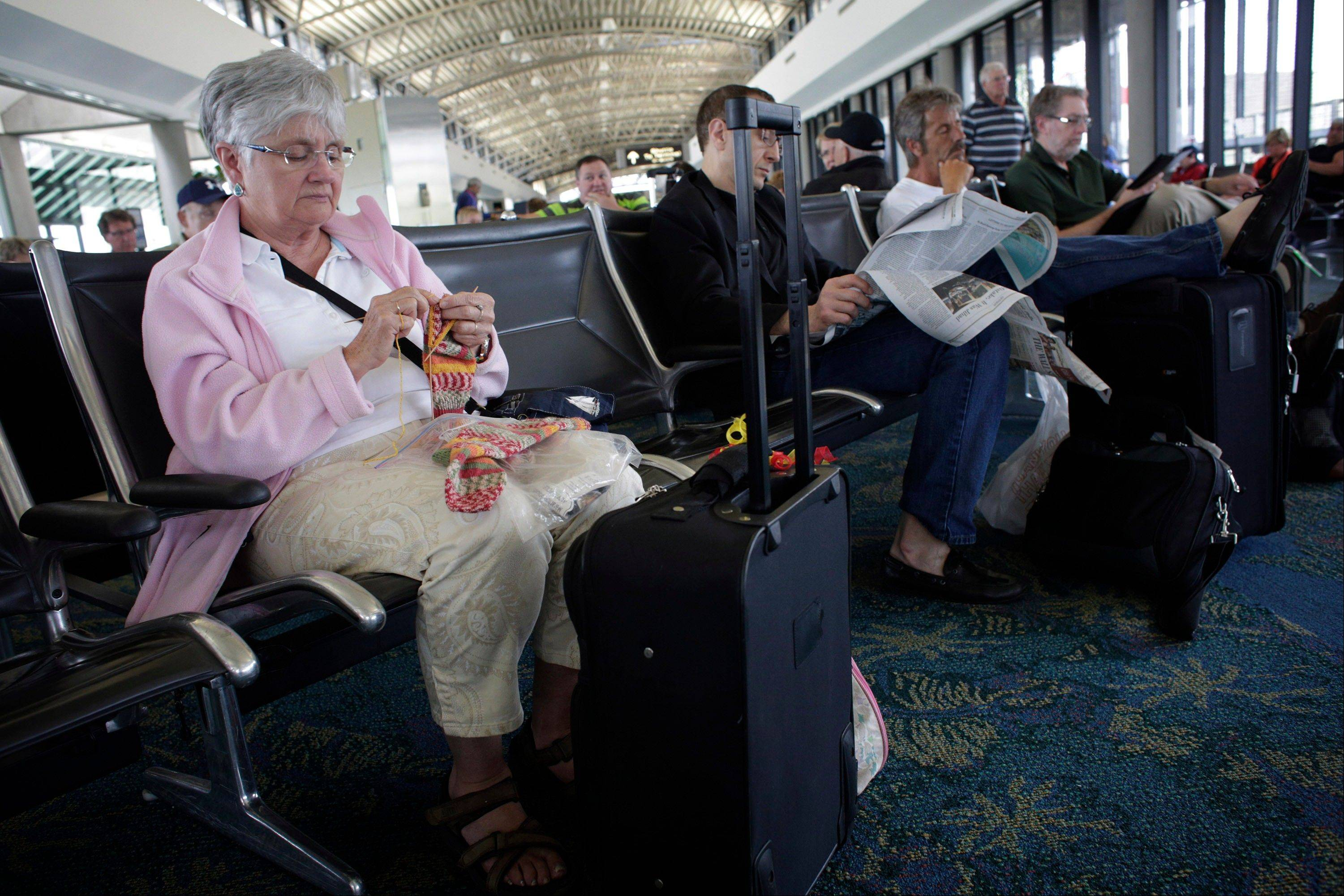 Penny MacDonald was supposed to depart Tampa International Airport on Monday at 1:40, but her flight to Toronto had been delayed to 3:10. She passed the time by knitting at the gate.