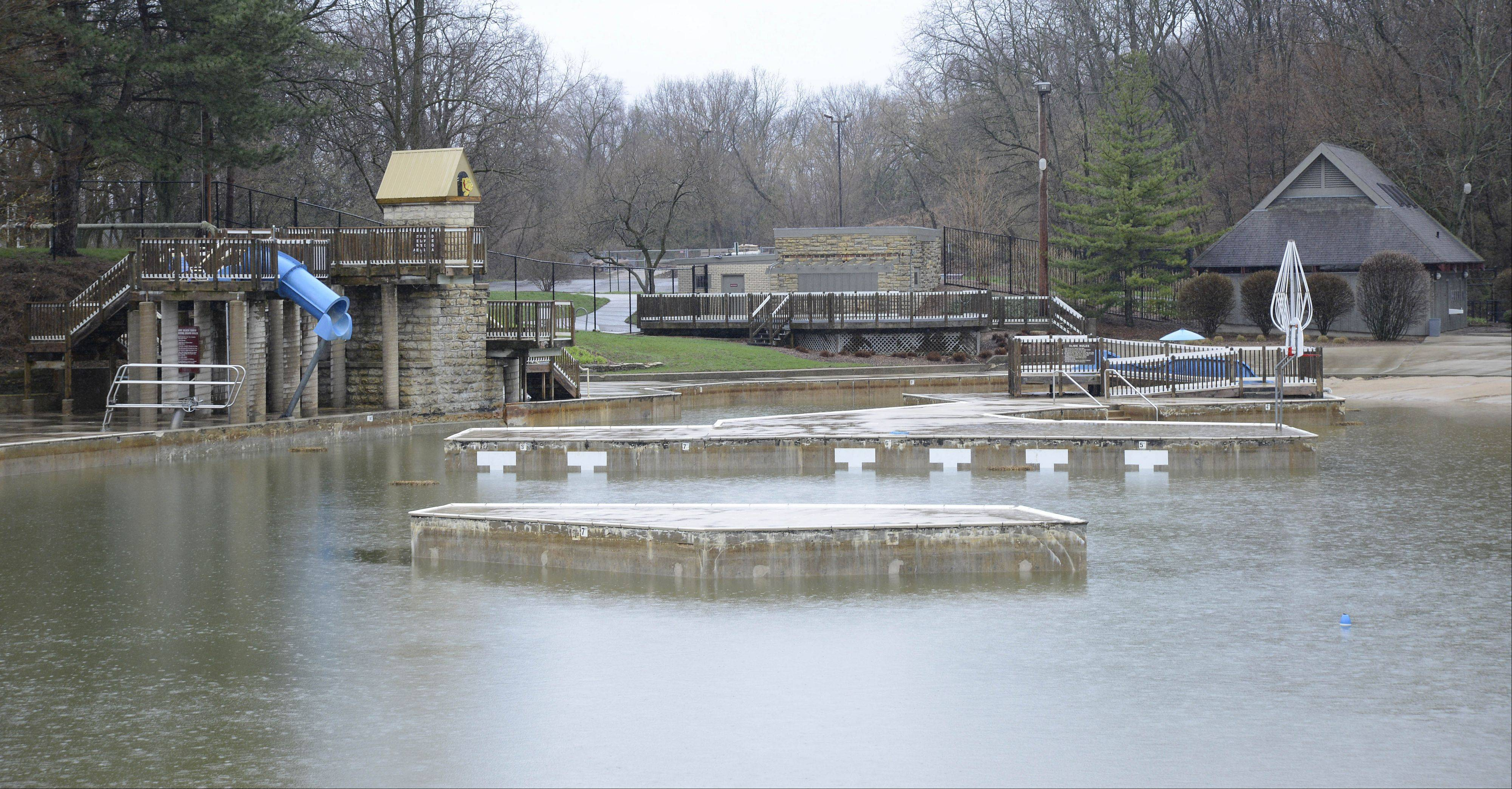 Batavia's Harold Hall Quarry Beach remained filled with rain water Tuesday, stalling preparation to open for the summer season.
