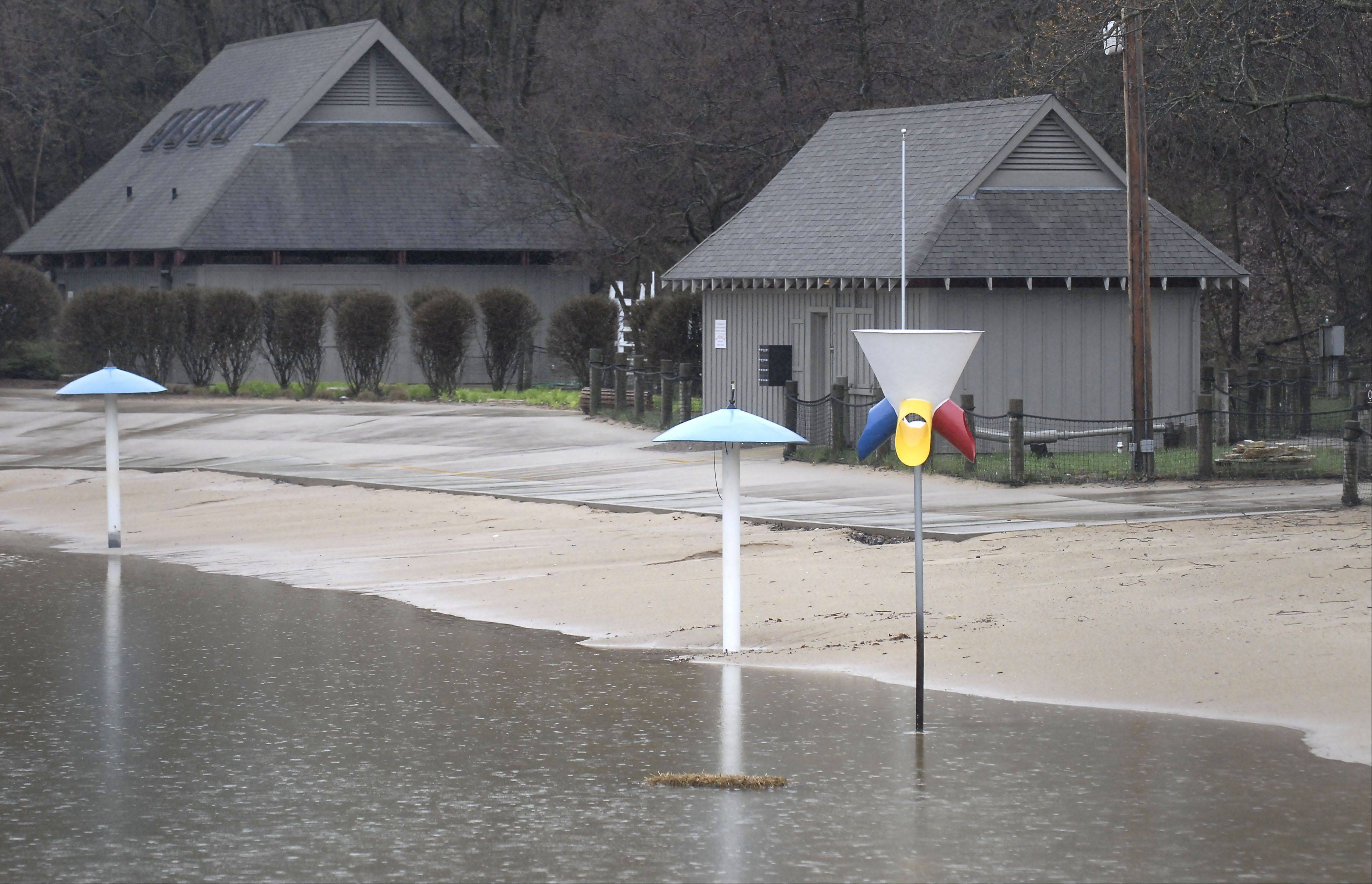 Batavia's Harold Hall Quarry Beach is filled with rain water Tuesday, stalling preparation to open for the summer season.