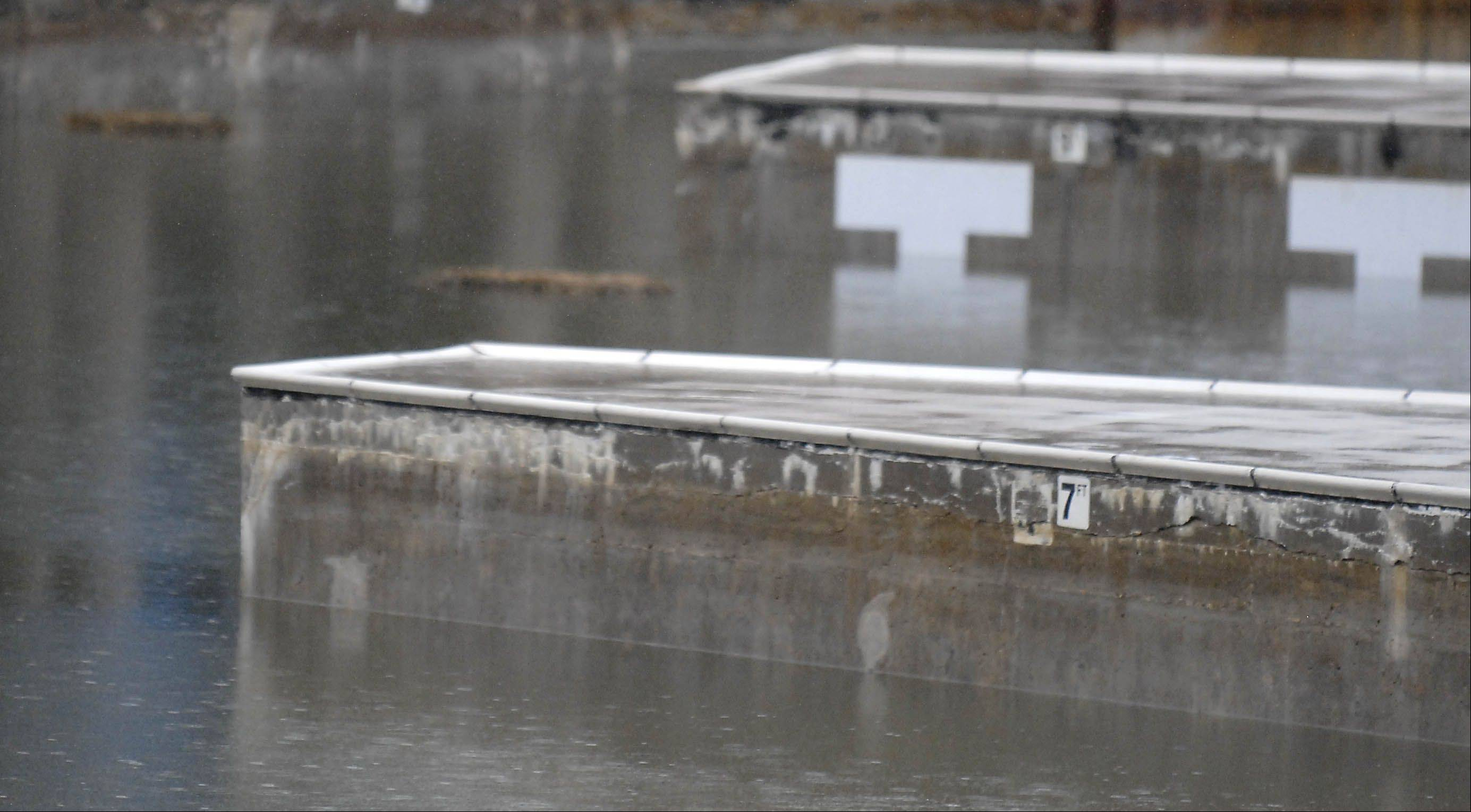 Batavia's Harold Hall Quarry Beach is filled with rain water Tuesday, preventing preparation work to open for the summer season.