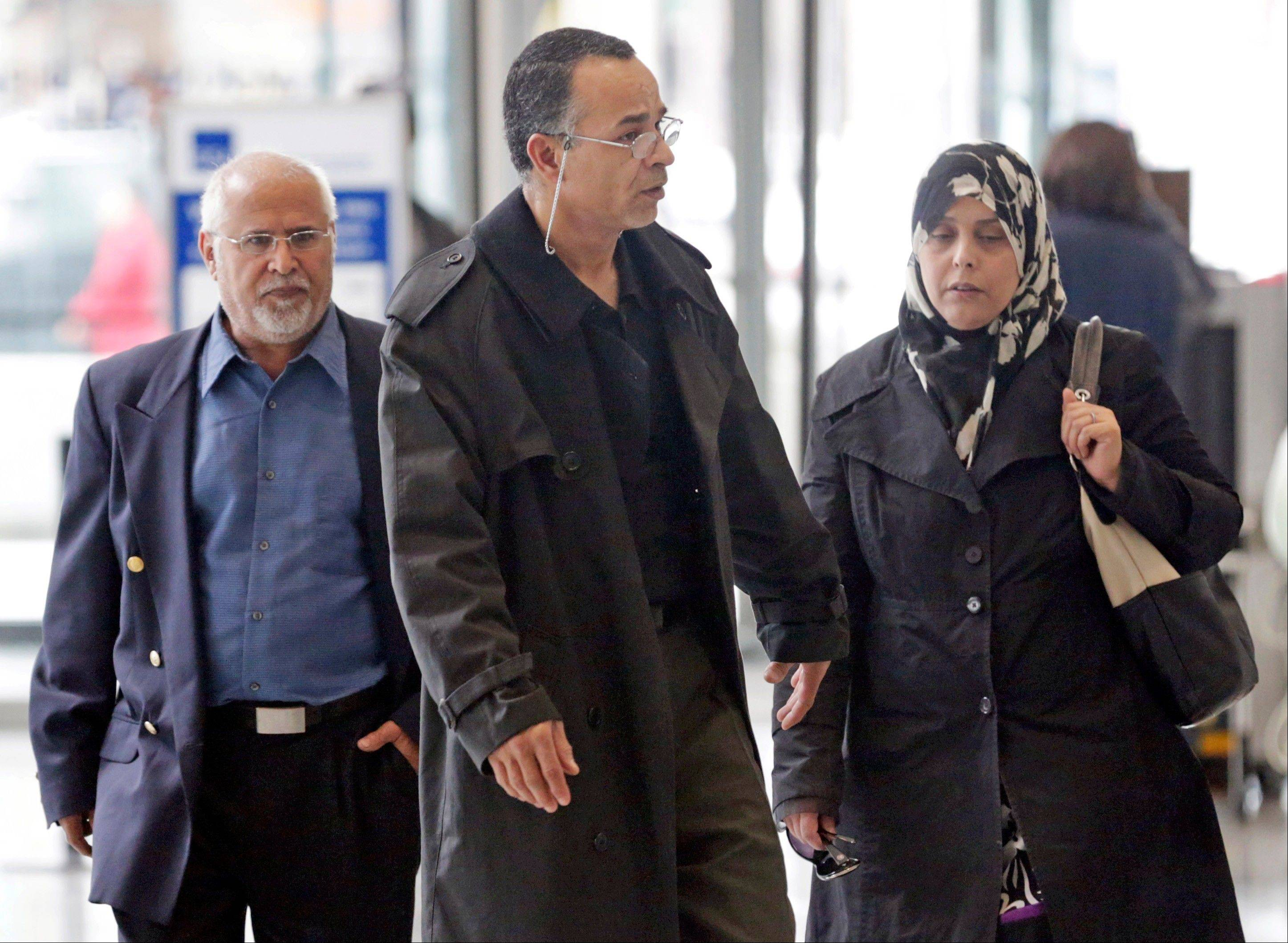 Family members of 18 year-old Abdella Ahmad Tounisi, including his father, Ahmad Tounisi, center, leave the Dirksen Federal Building on Tuesday in Chicago. During a detention hearing, a federal judge said he'd delay a decision on the Aurora teen's bond until next week.
