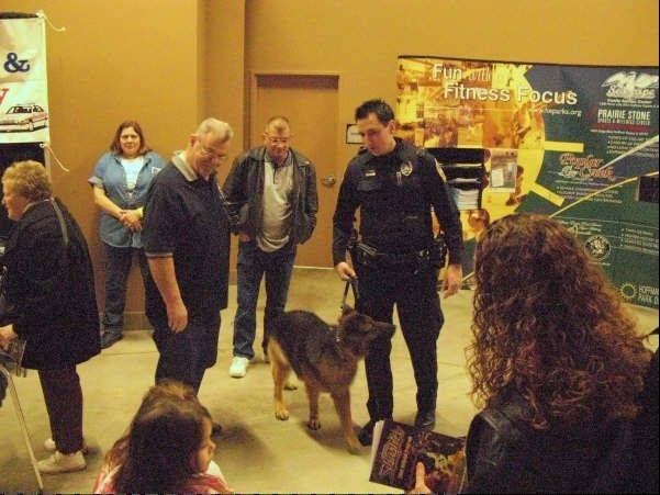 Hoffman Estates police officer Dan Donohue shows off Bundo, who until recently was the department's only K-9 officer. With Bundo retiring this month, the Hoffman Estates Citizen Police Academy Alumni Association is hosting a fundraiser May 5 to help the department purchase a new dog.