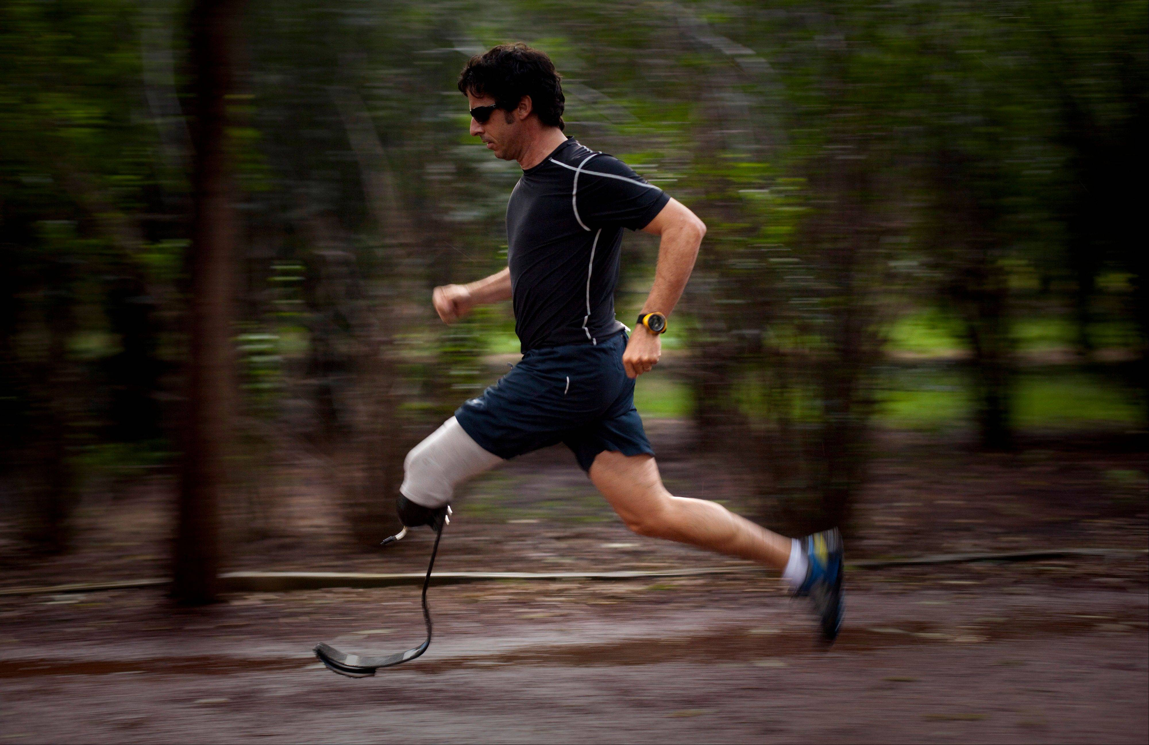 "In this 2010 photo, Associated Press photographer Emilio Morenatti runs in a Mexico City public park, one year after he lost his leg during an attack while on assignment in Afghanistan. ""If you don't confront the feelings of loss, the fact that your world has changed, you never fully recover from the amputation,"" writes Morenatti."